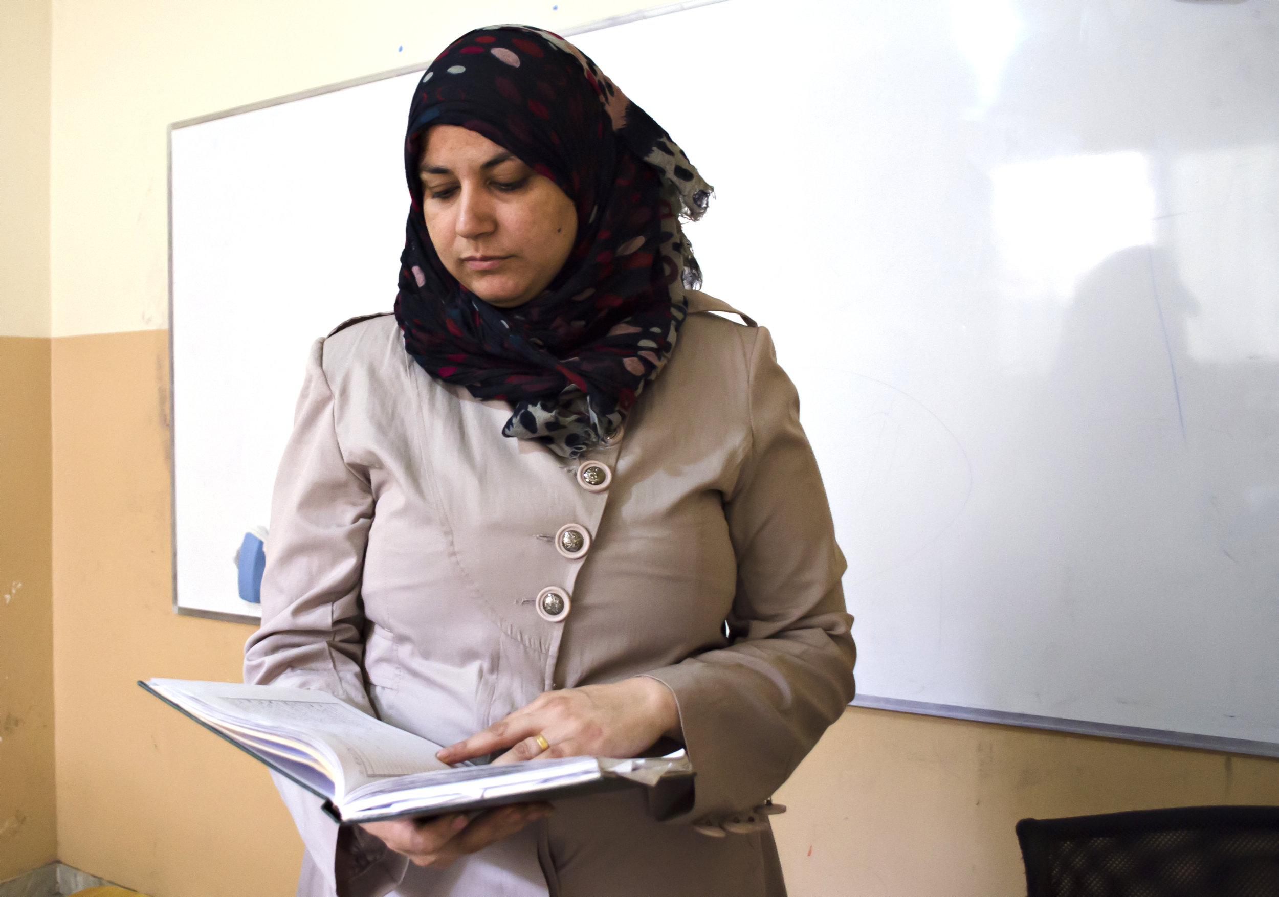 Hind El Hamar checks her lesson plan at Al Naqab. (The Daily Star/Antoine Abou-Diwan)