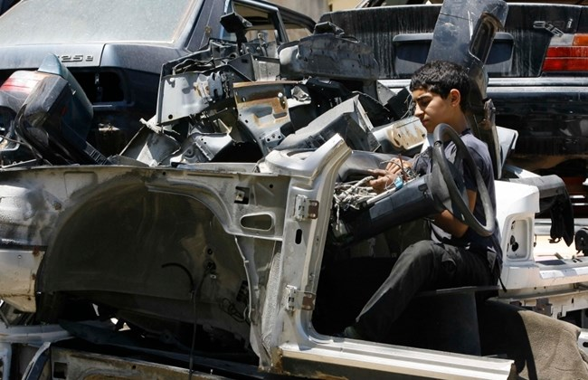 A boy works at a car repair shop. (The Daily Star/Mohammed Zaatari)