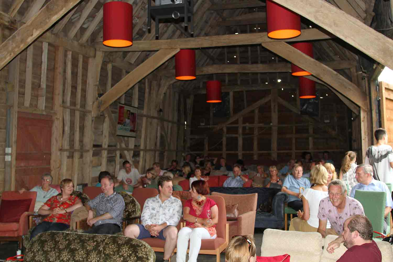 Our lovely threshing barn adorned with shades and ecclectic mix of comfy sofas
