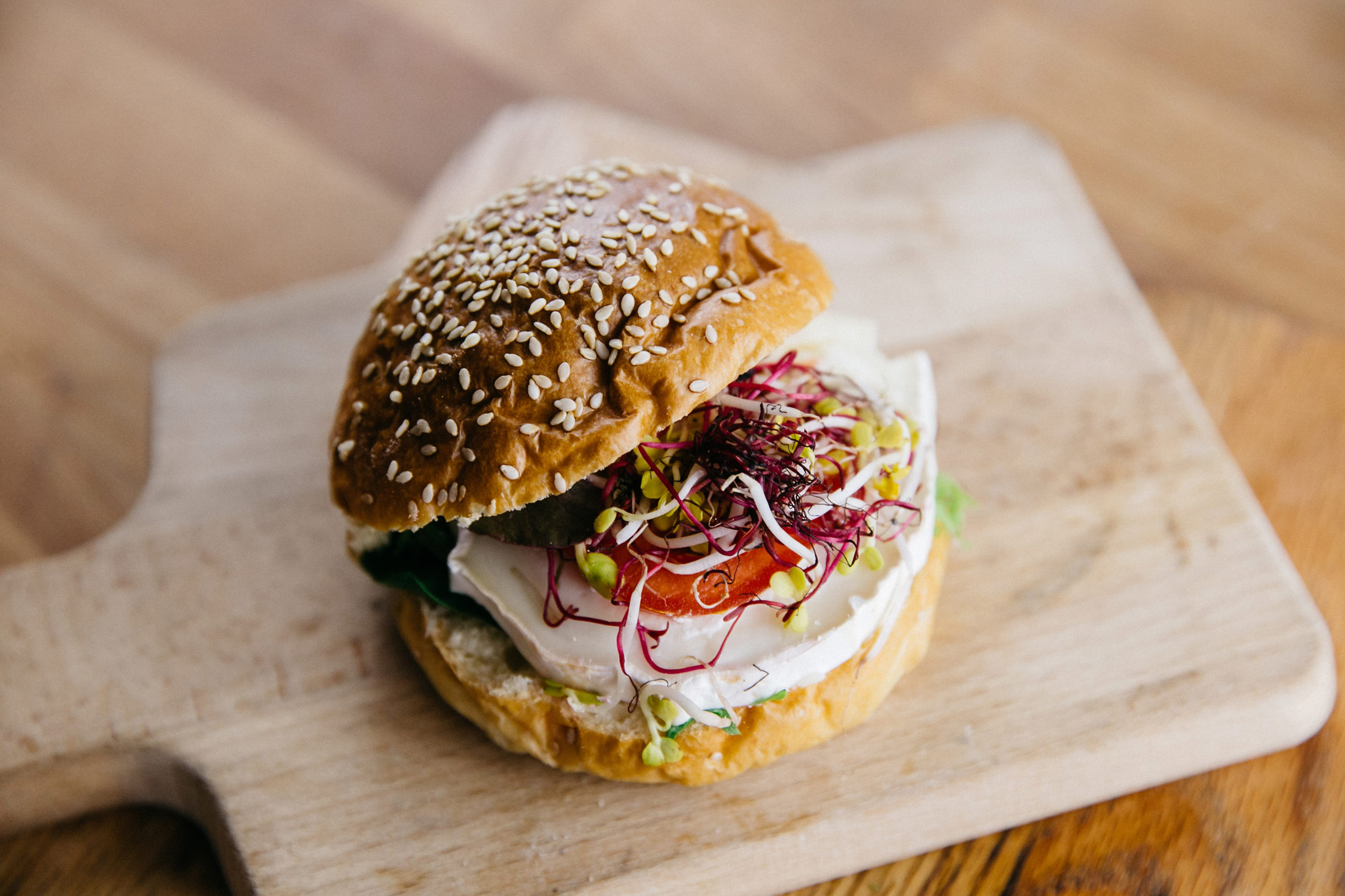 Sesame Burger Bun with goat cheese and tomato