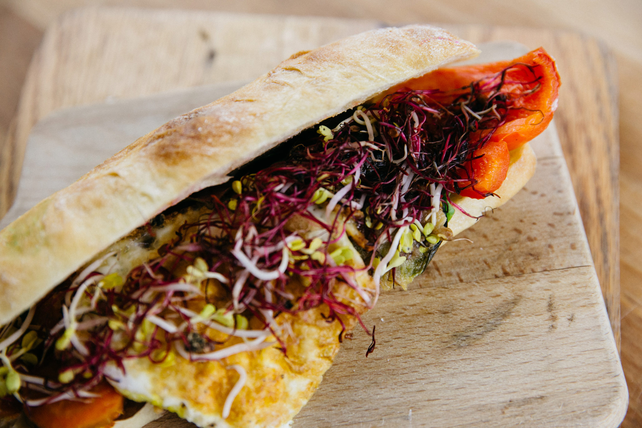 Our Ciabatta with grilled vegetables, fried egg & sprouts