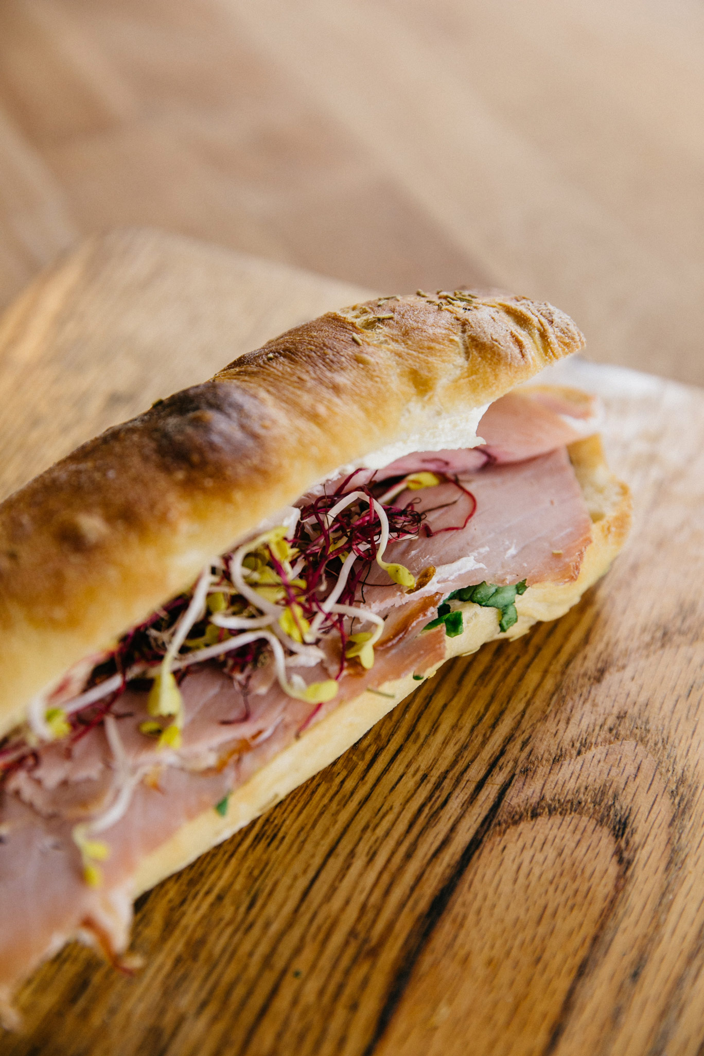 Our rosemary ciabatta with ham, cream cheese and sprouts