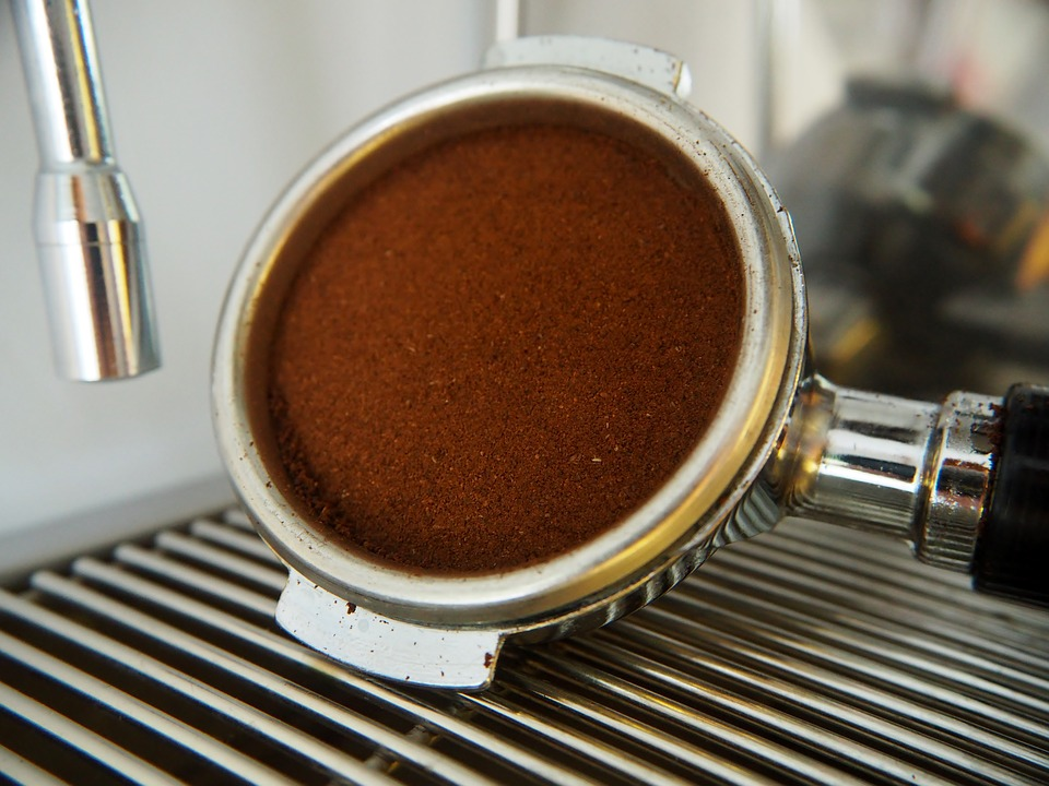 Portafilter containing a filter basket with finely ground coffee. We're ready to make some delicious espresso!