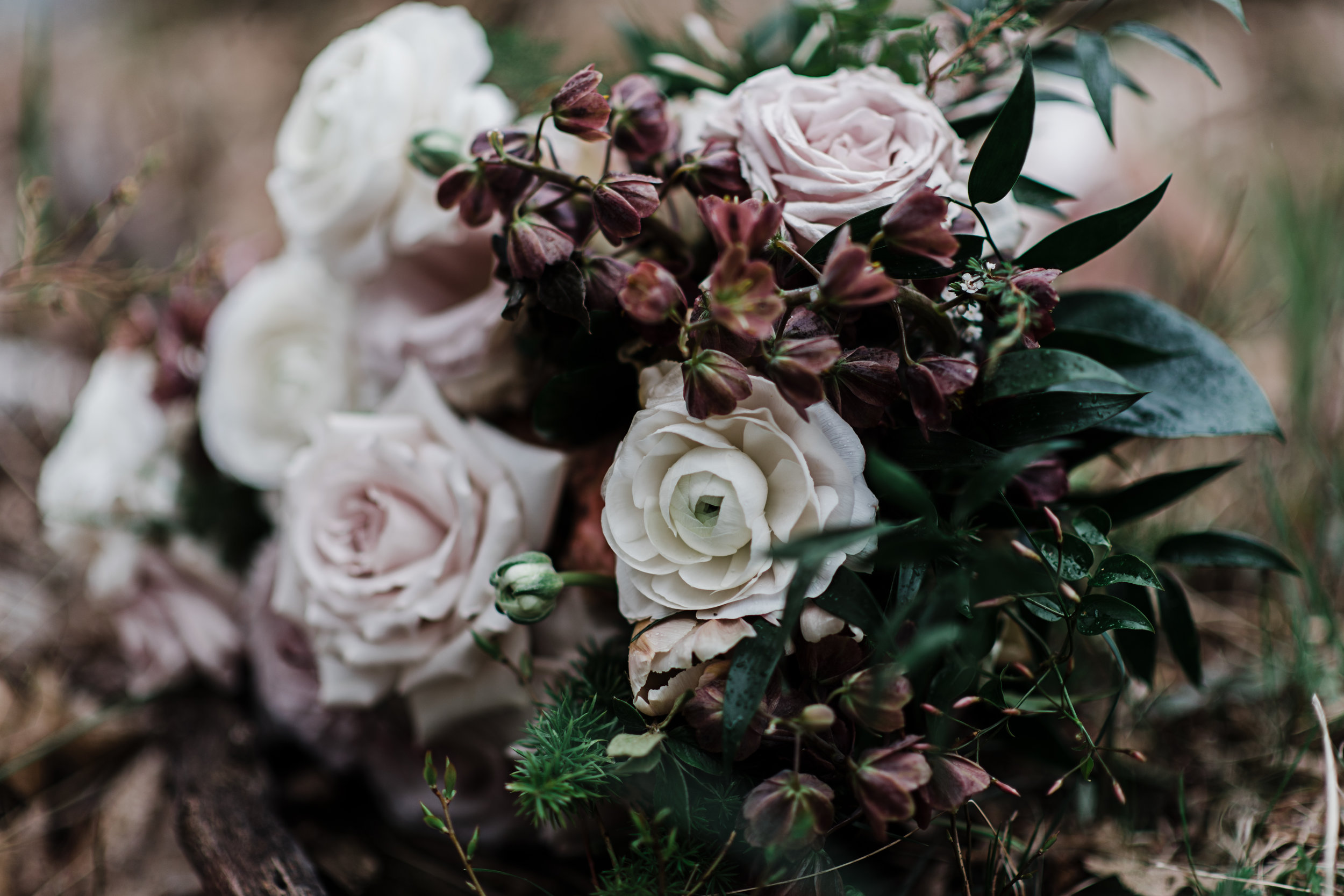 Bridal bouquet with soft pink roses and cream peonies and lush greens.