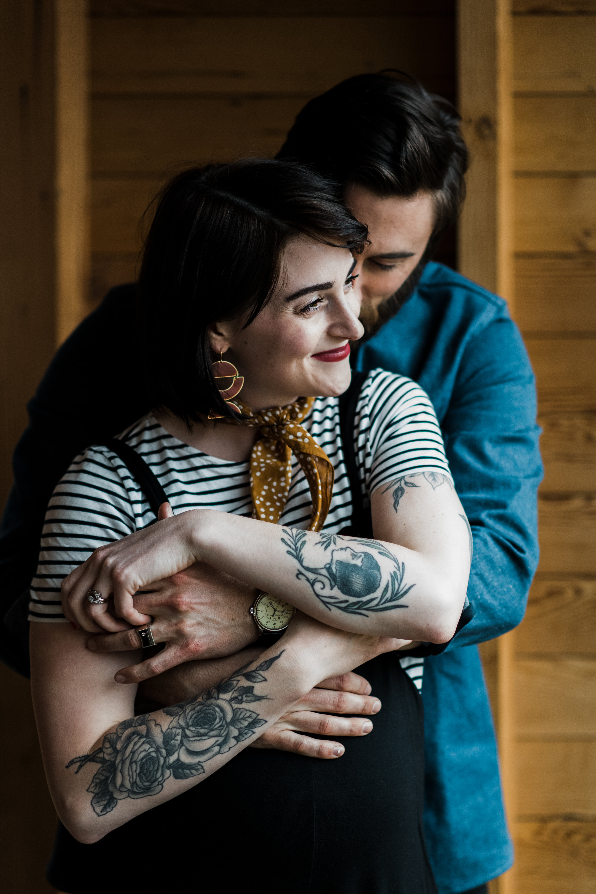 Photo of a couple with arms wrapped around each other at a cabin on Two Bear Lake in Weyerhauser, WI.