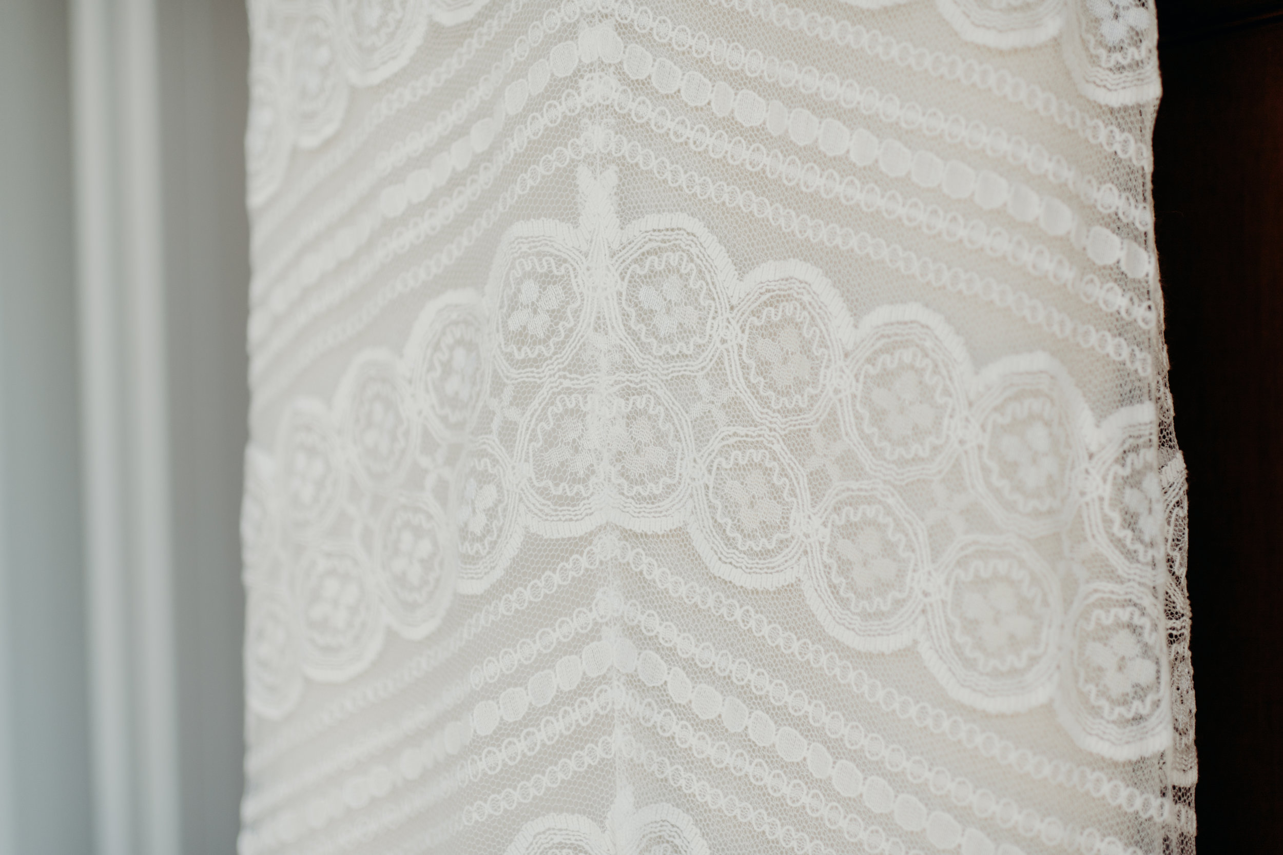 Lace detail of wedding dress.