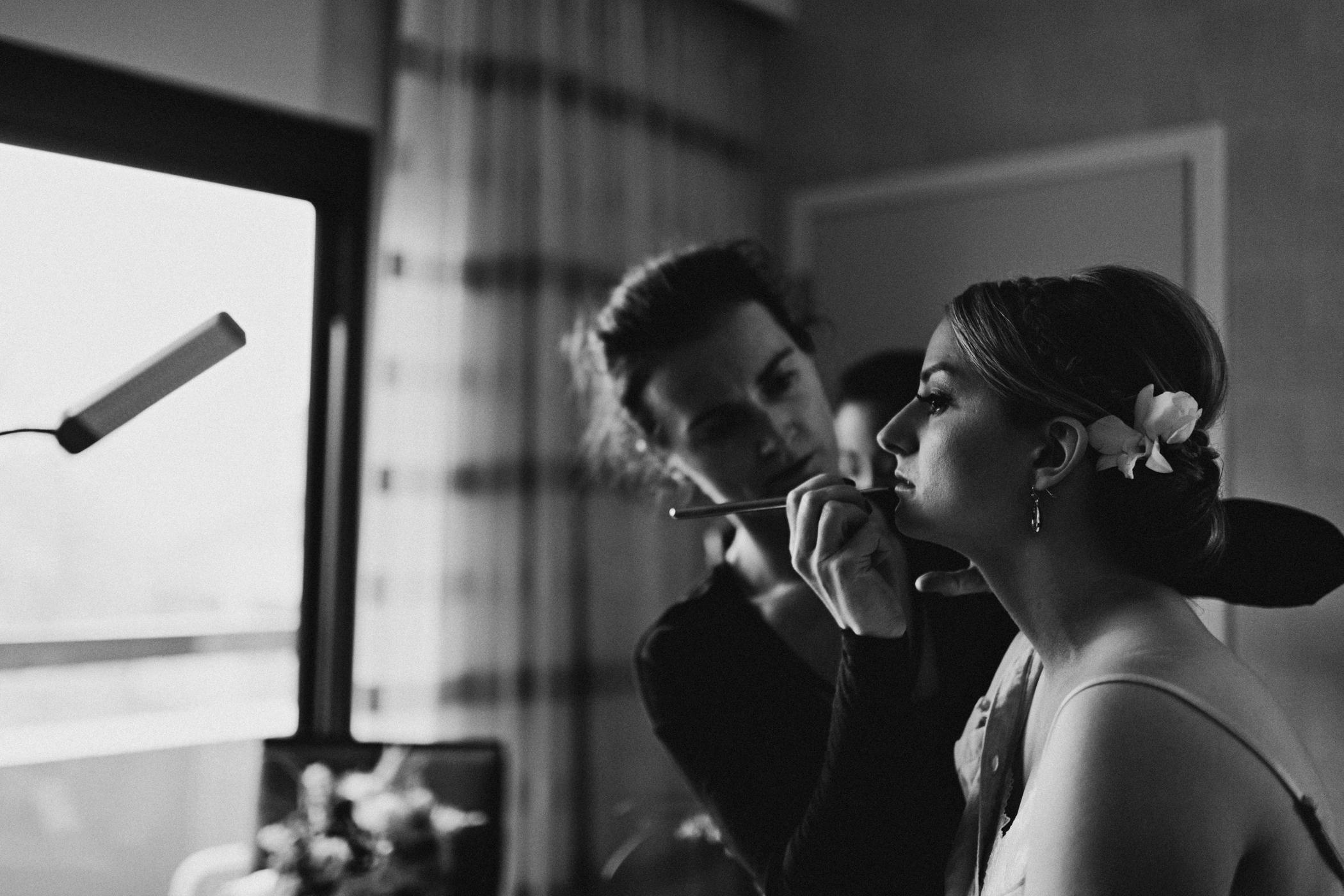 Bride gets lip liner applied