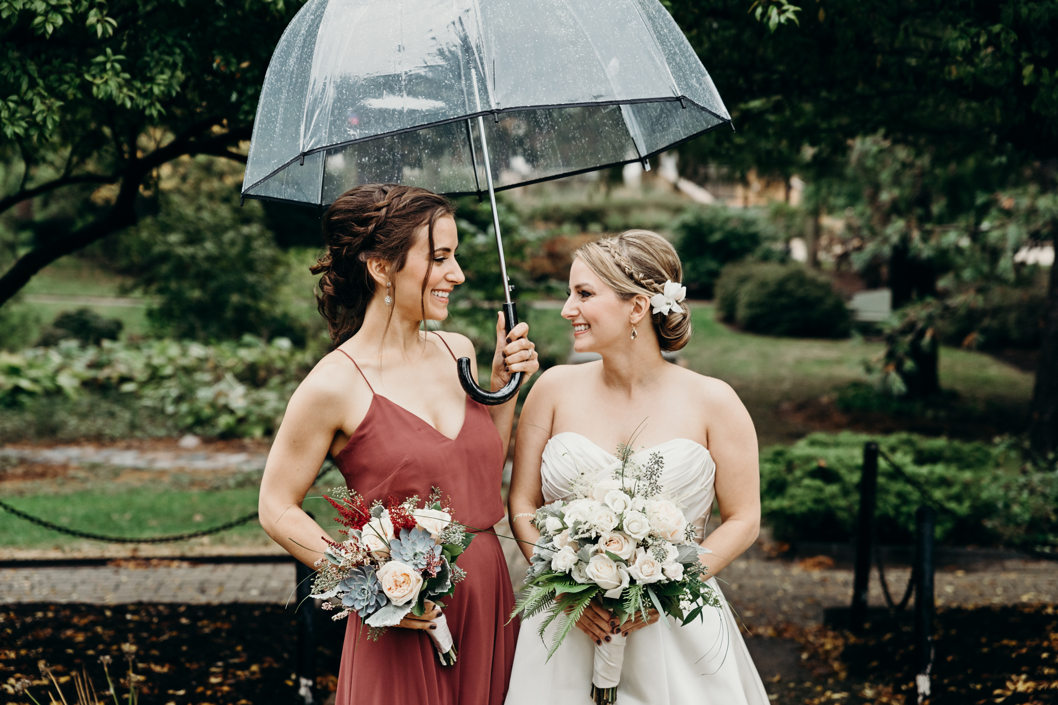Bride and her maid of honor smile at each other