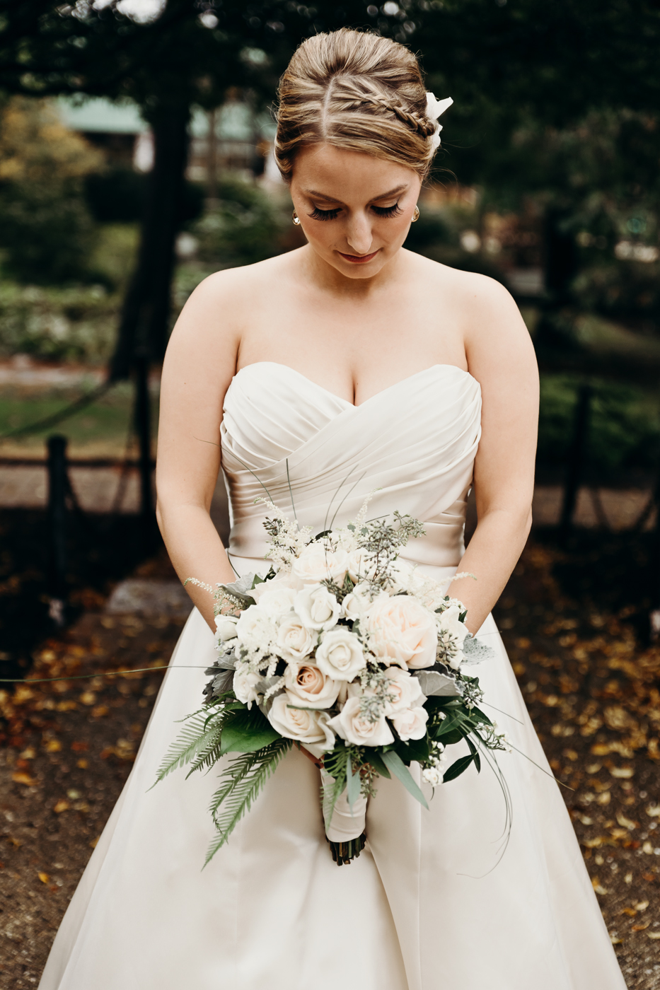 Bride looks down at her bouquet