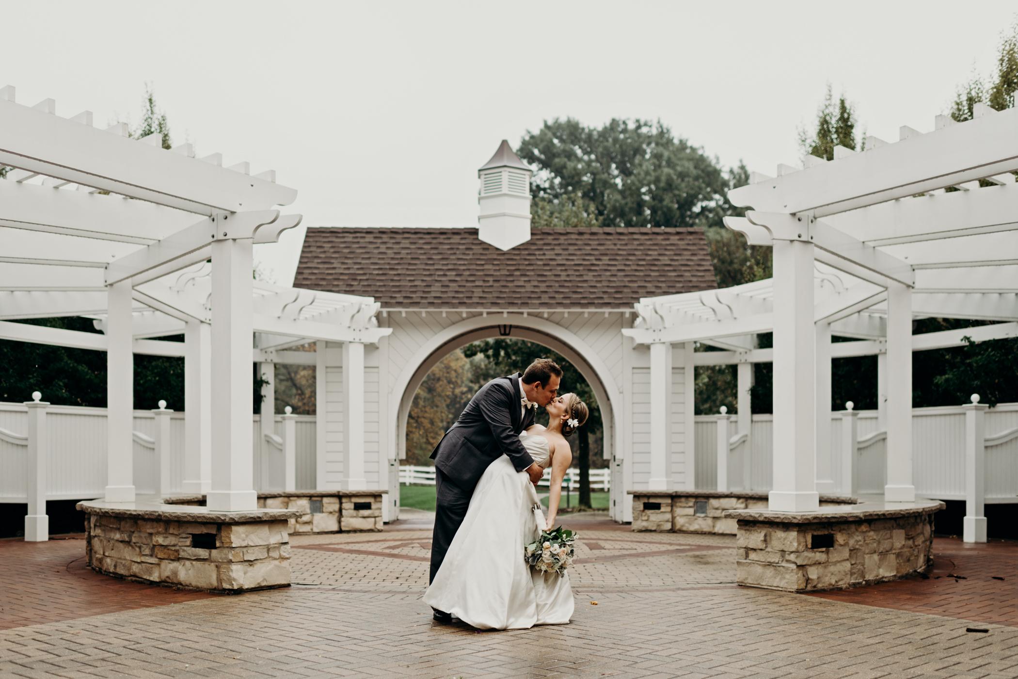 Groom dips bride at Danada House