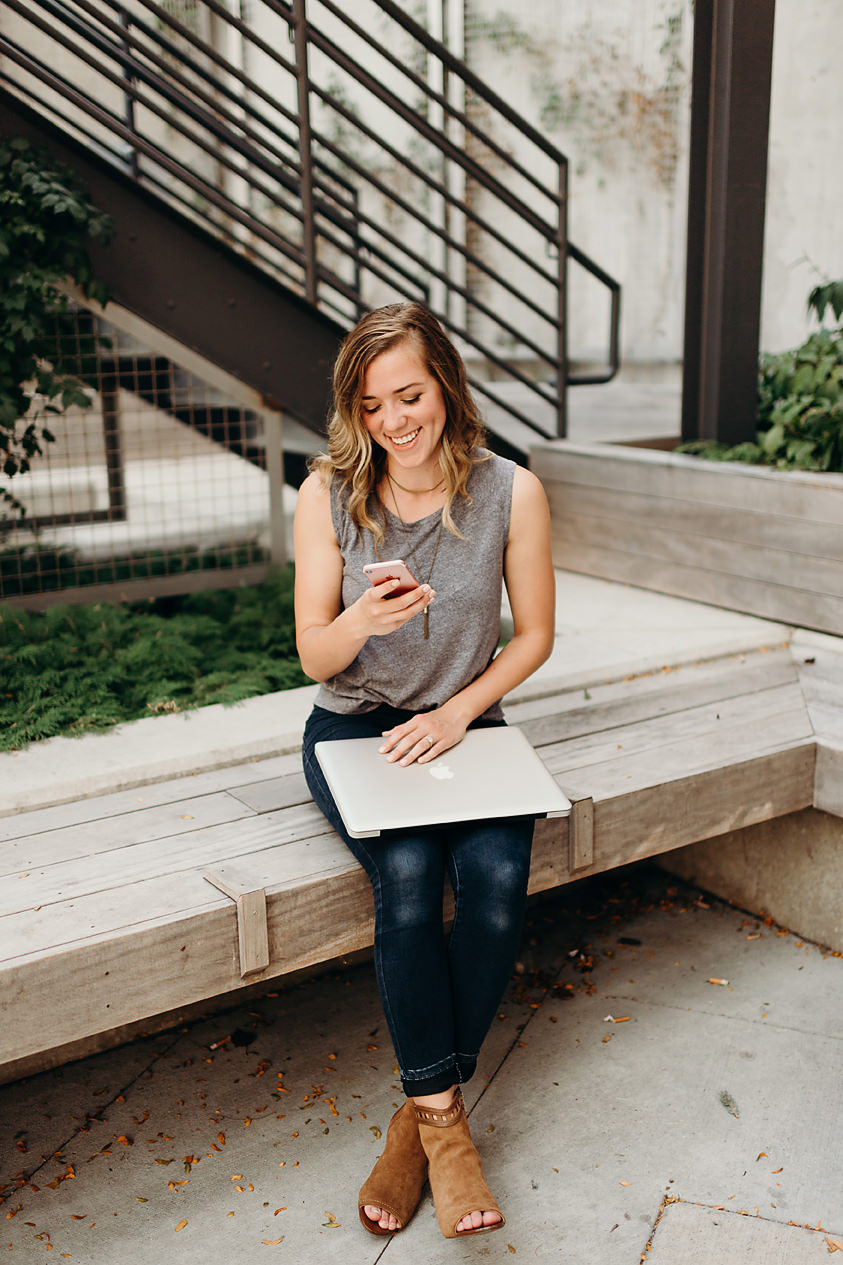 Small business owner checking text messages