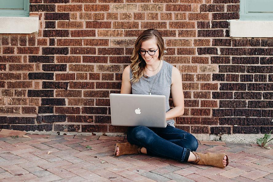 Entrepreneur working outside on laptop