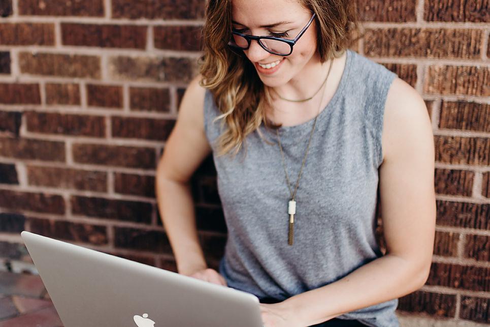 Entrepreneur smiling with laptop
