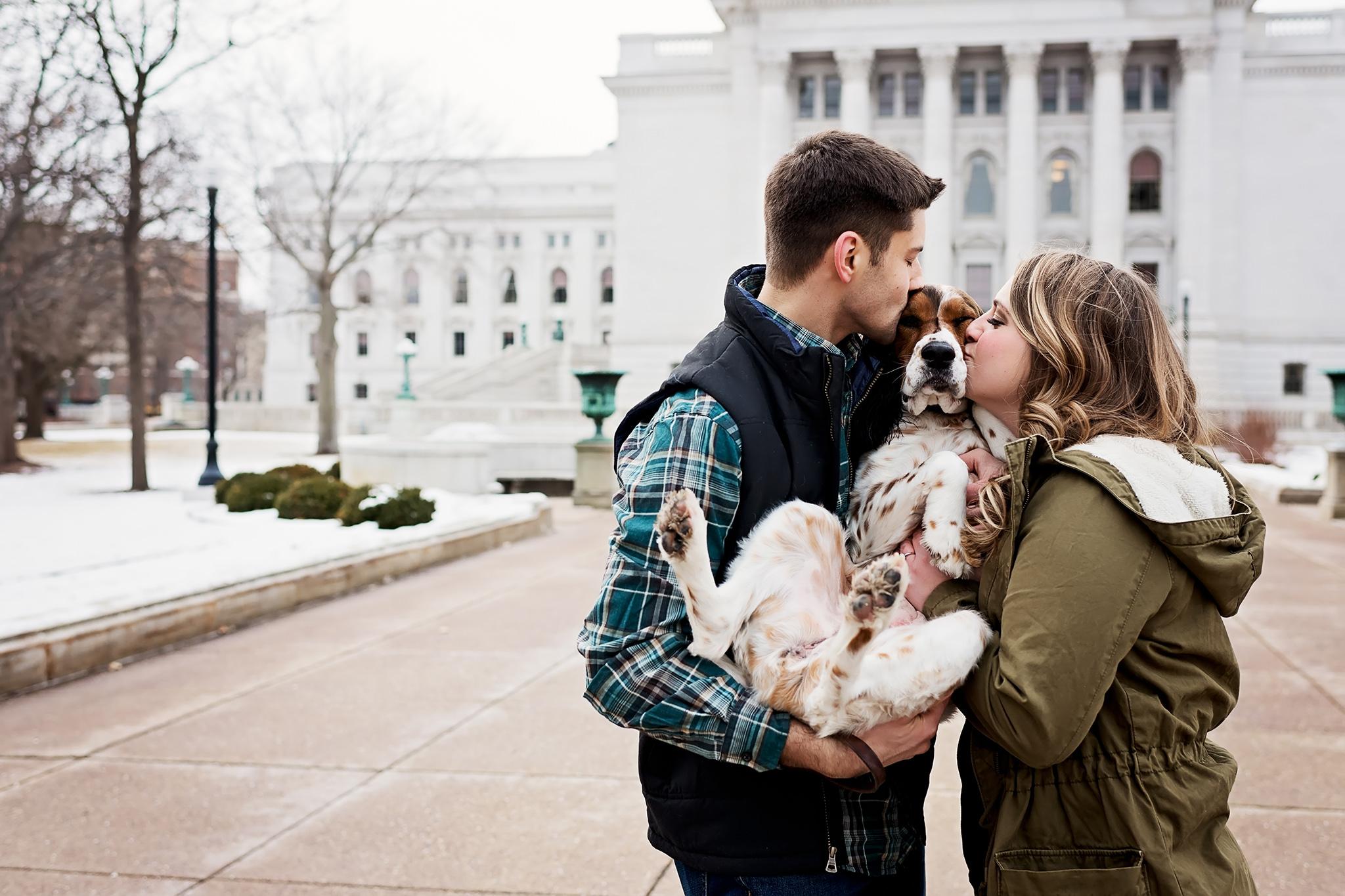 Couple kissing dog