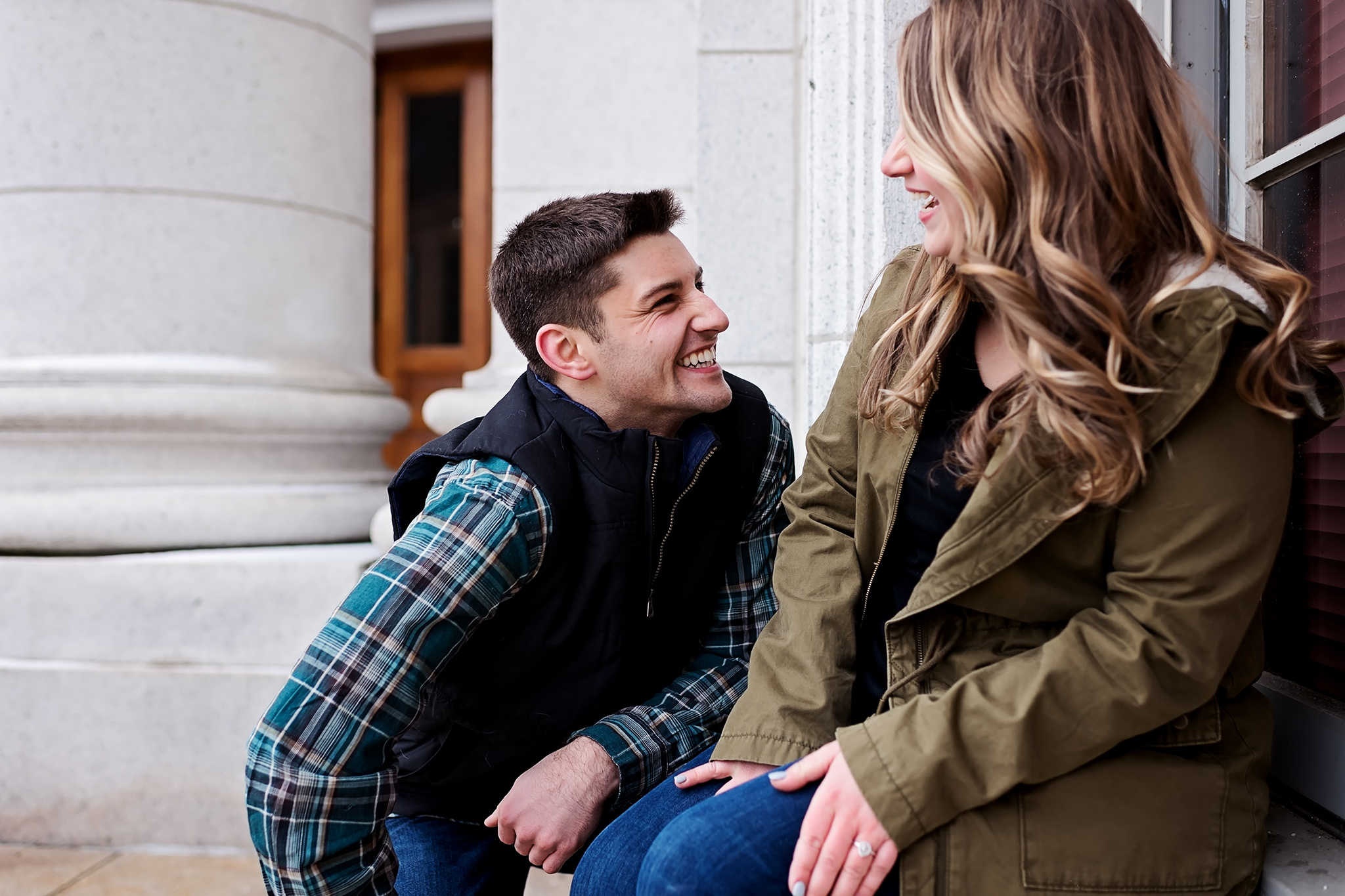 Man down on one knee pretending to propose at Wisconsin state capitol