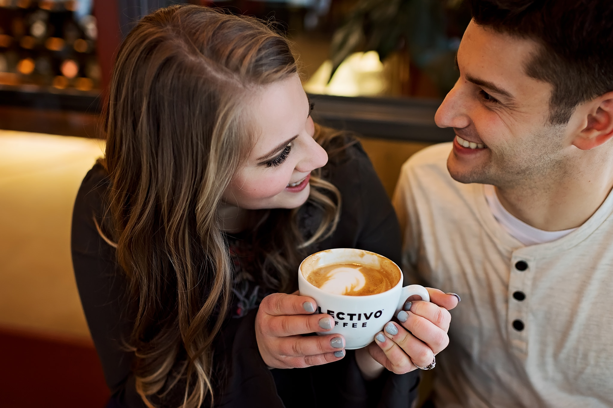 Couple laughing over a cup of coffee