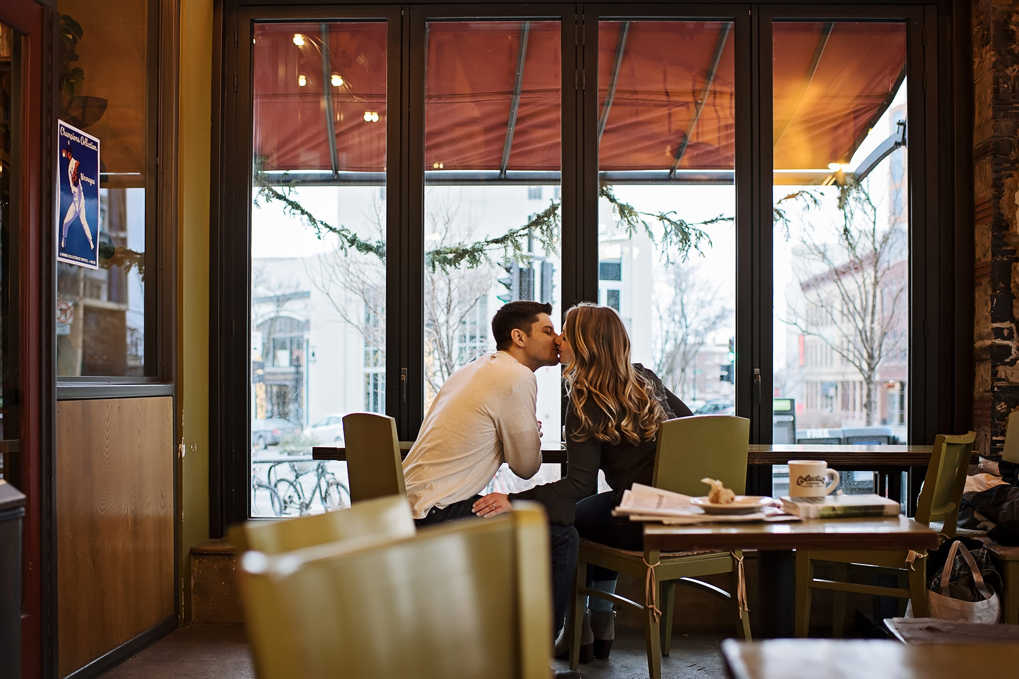 Couple kissing in a coffee shop