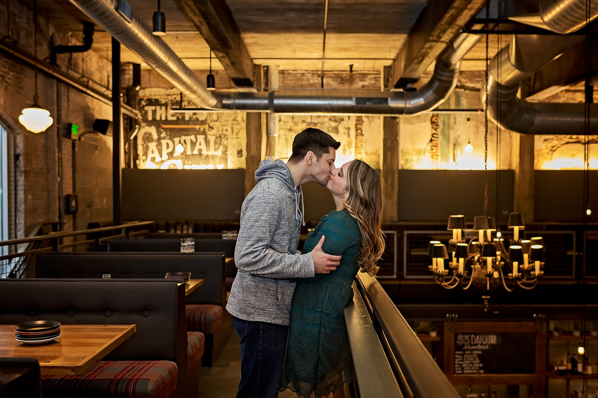 Couple kissing inside Lucille in downtown Madison, WI