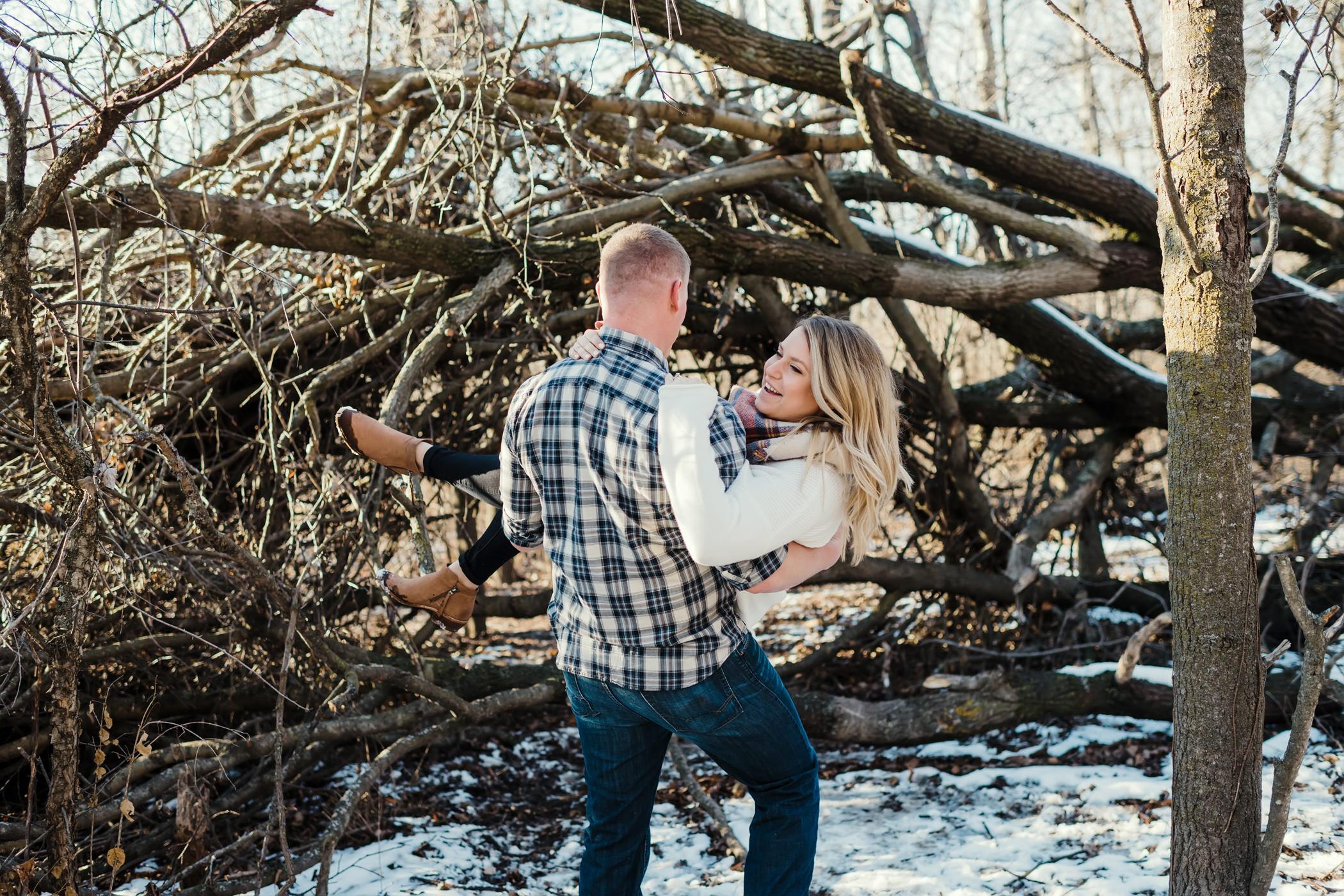 Man carries his fiancé