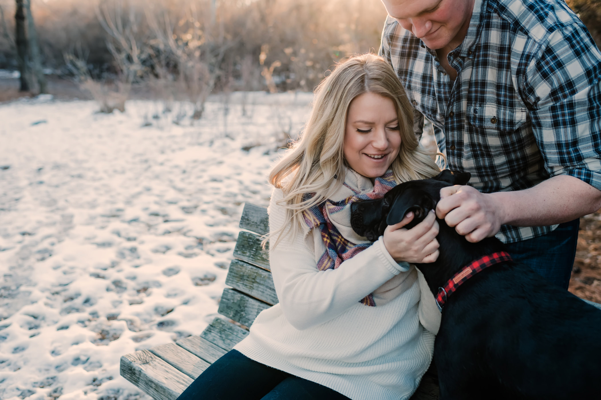 Couple petting their dog