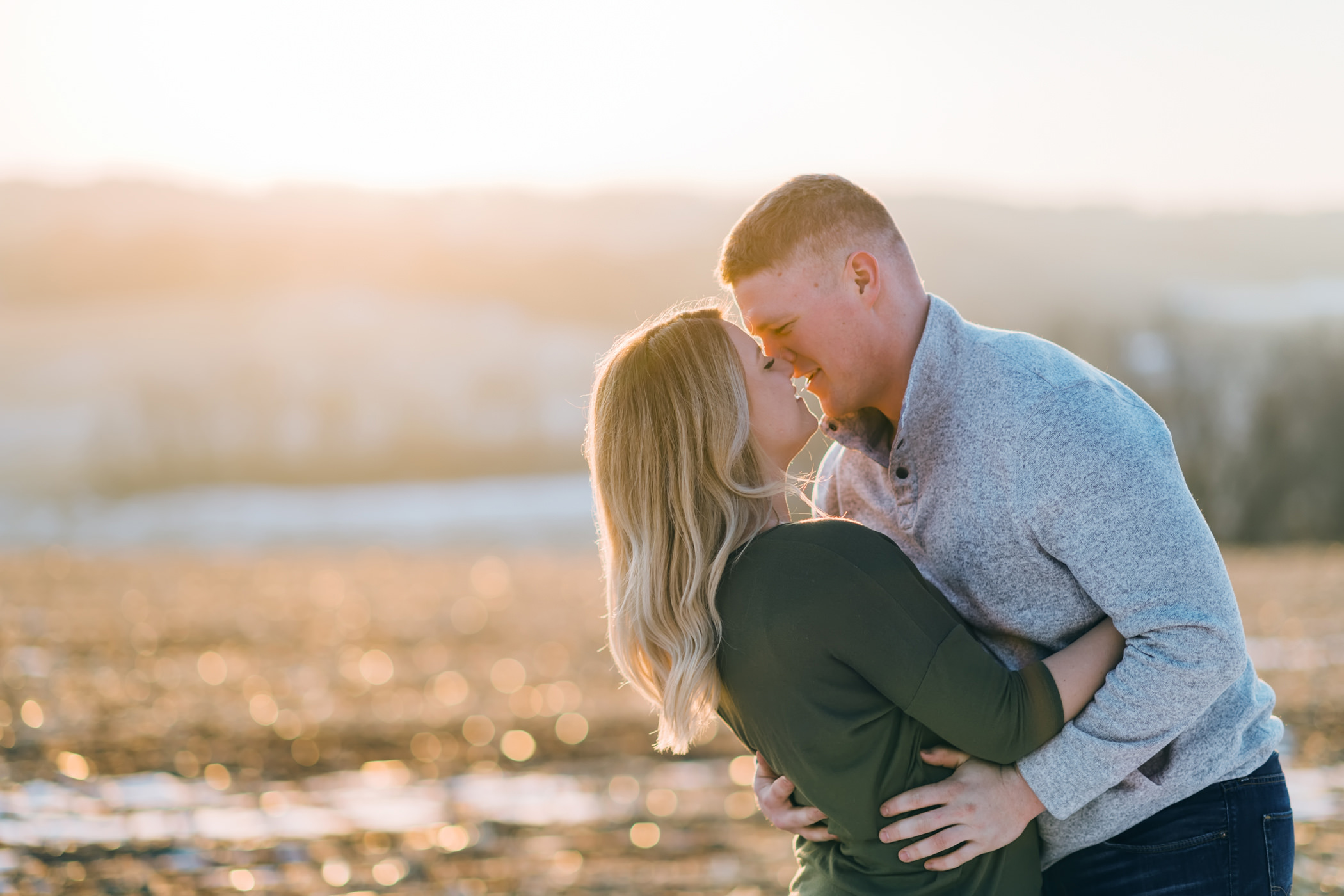 Couple about to kiss at sunset