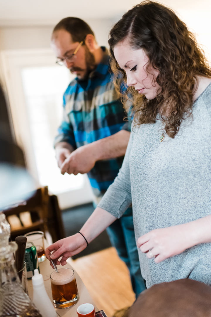 Engaged couple making brandy old fashioned together