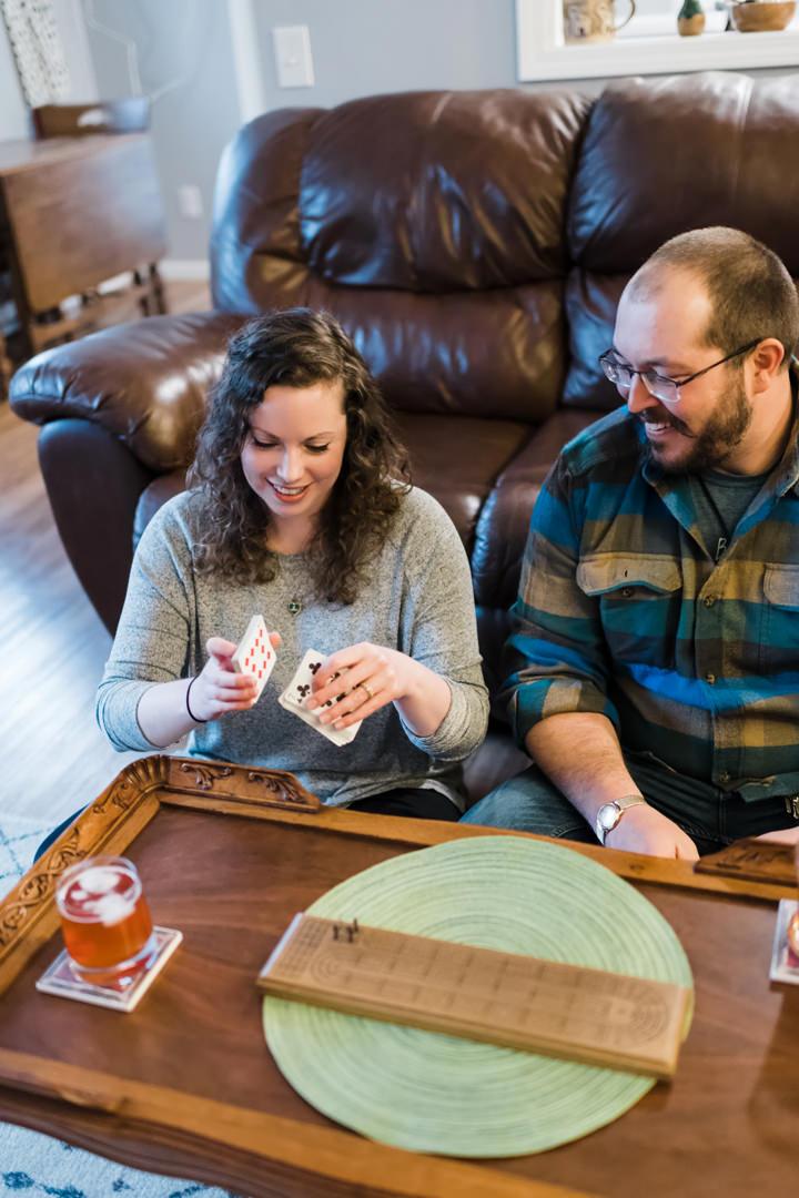 Engaged couple playing cribbage