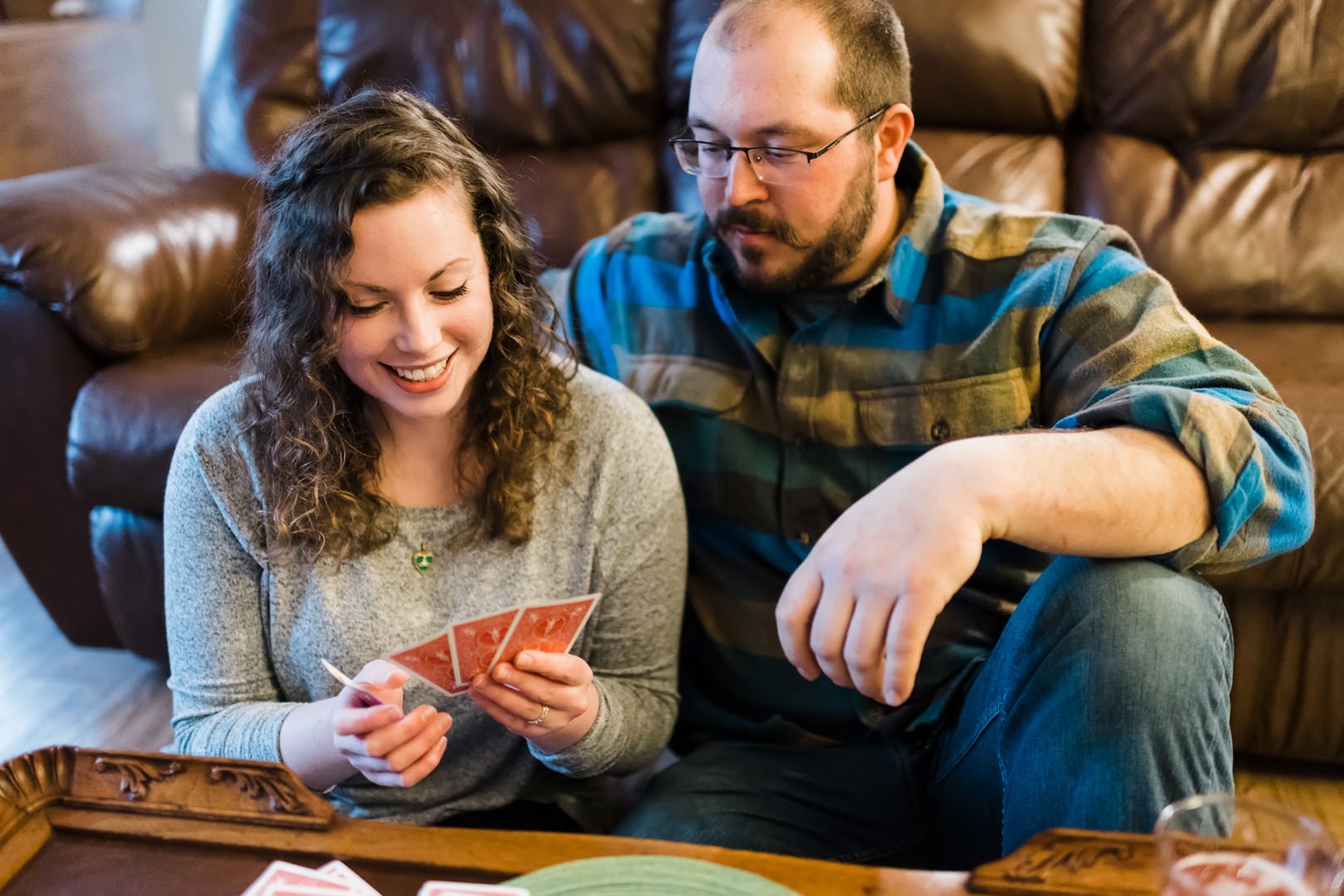 Woman smiles at her good cribbage hand