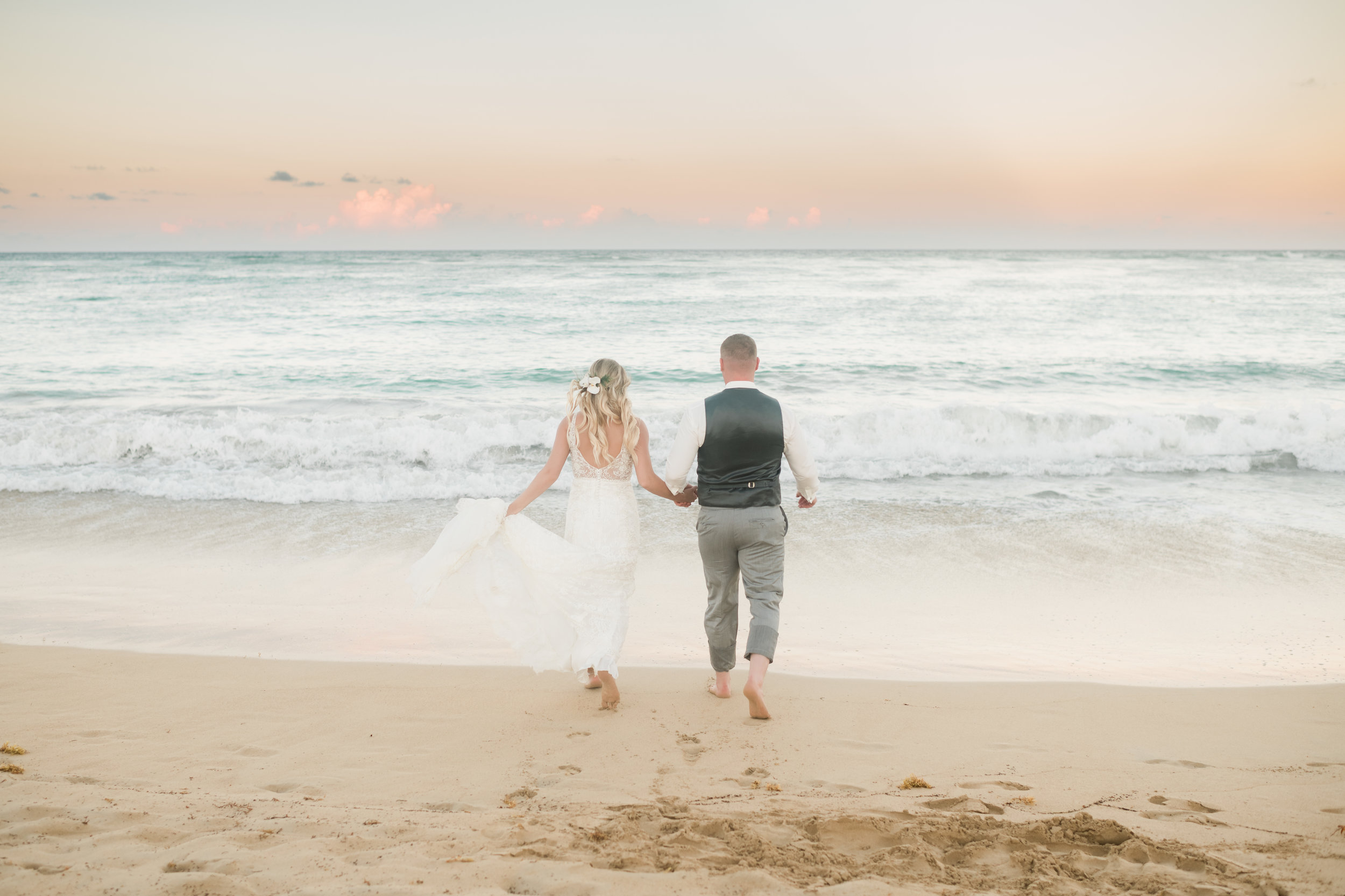 Couple walks toward the sunset and the ocean at a resort in Punta Cana, Dominican Republic.