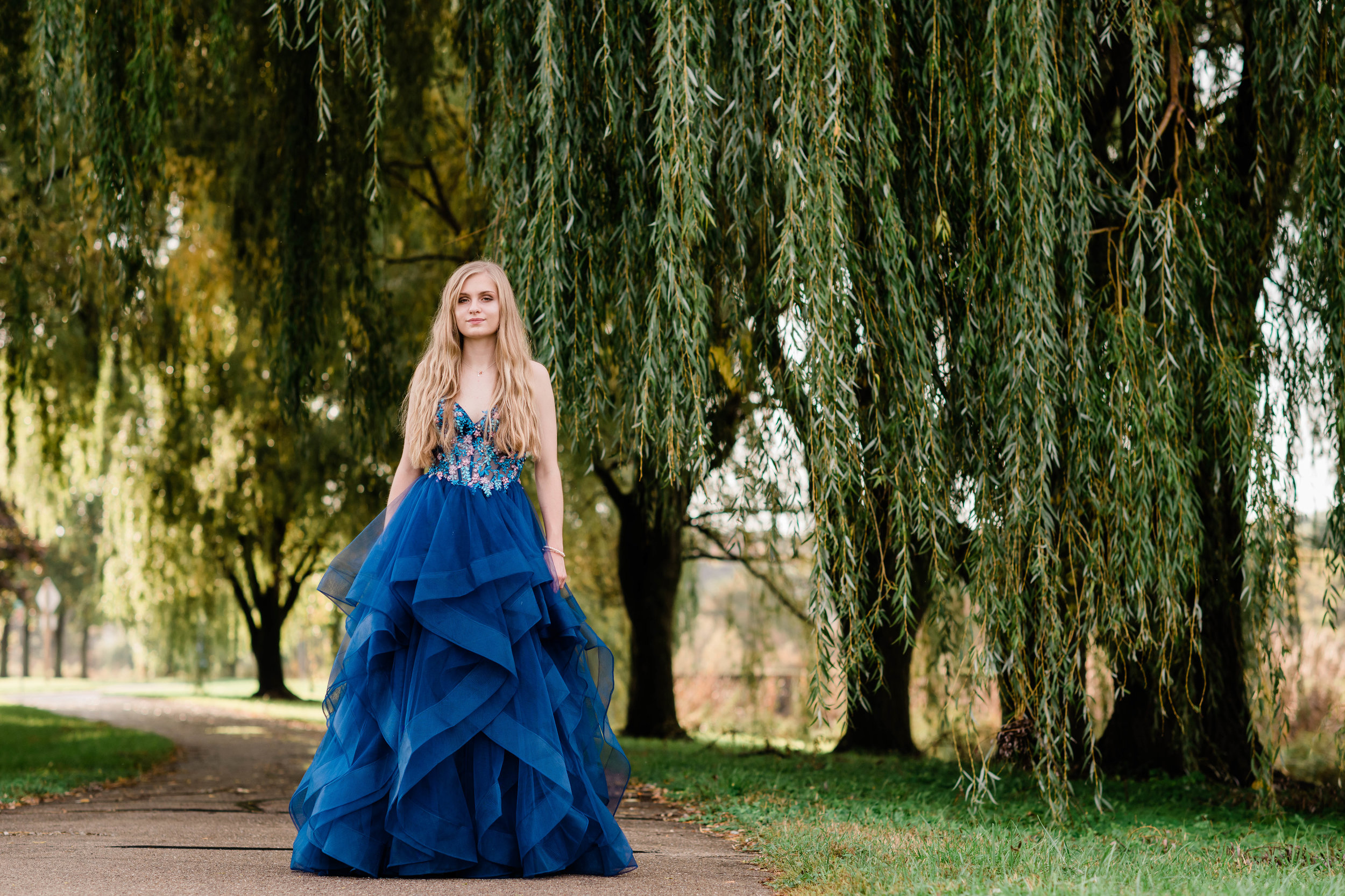 High school senior wears her prom dress