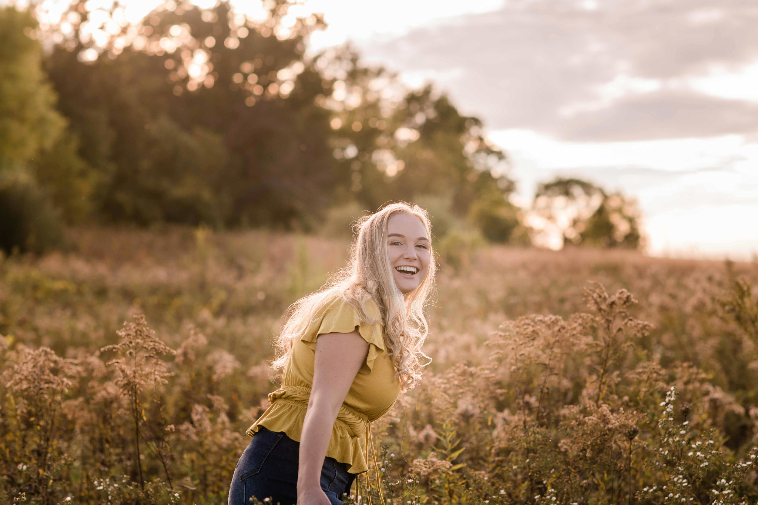 High school senior walking through a field