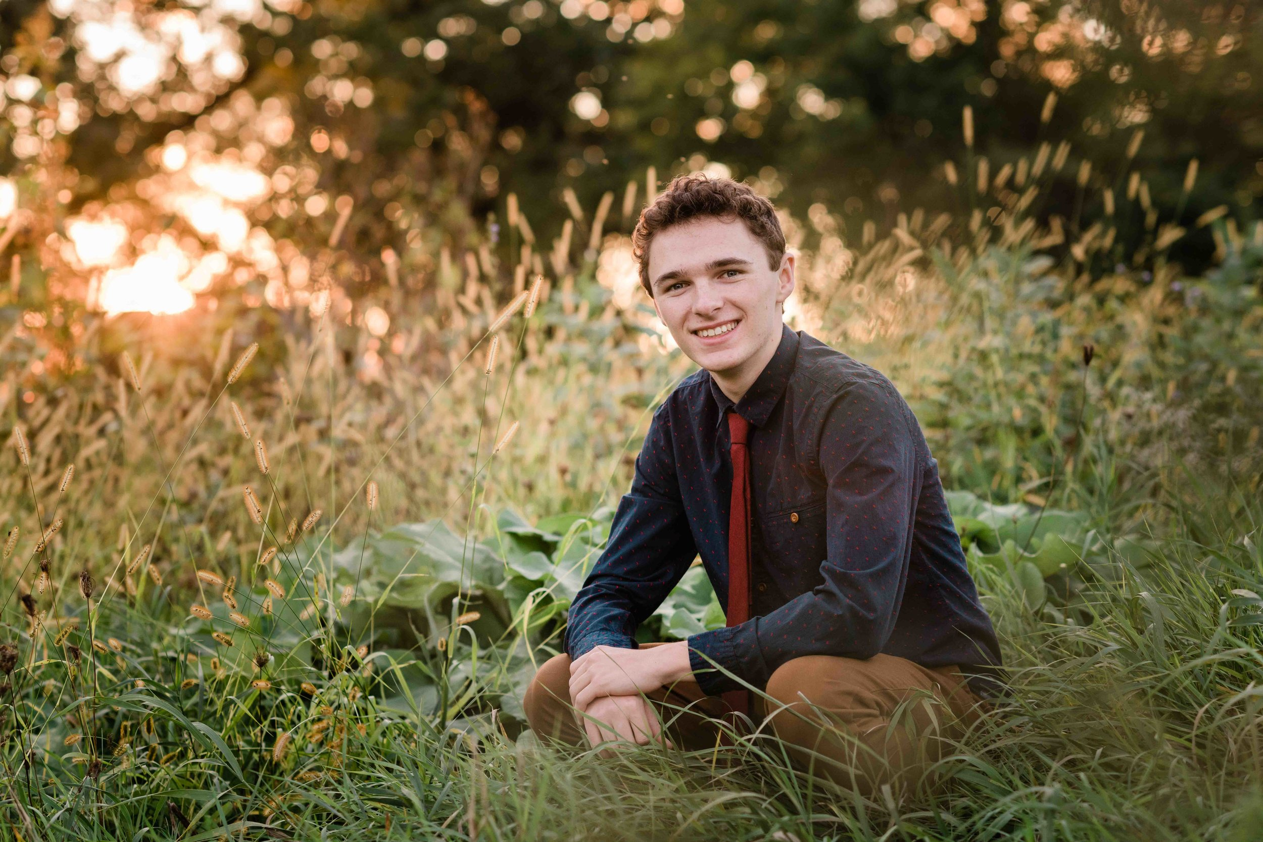 High school senior sitting in a garden