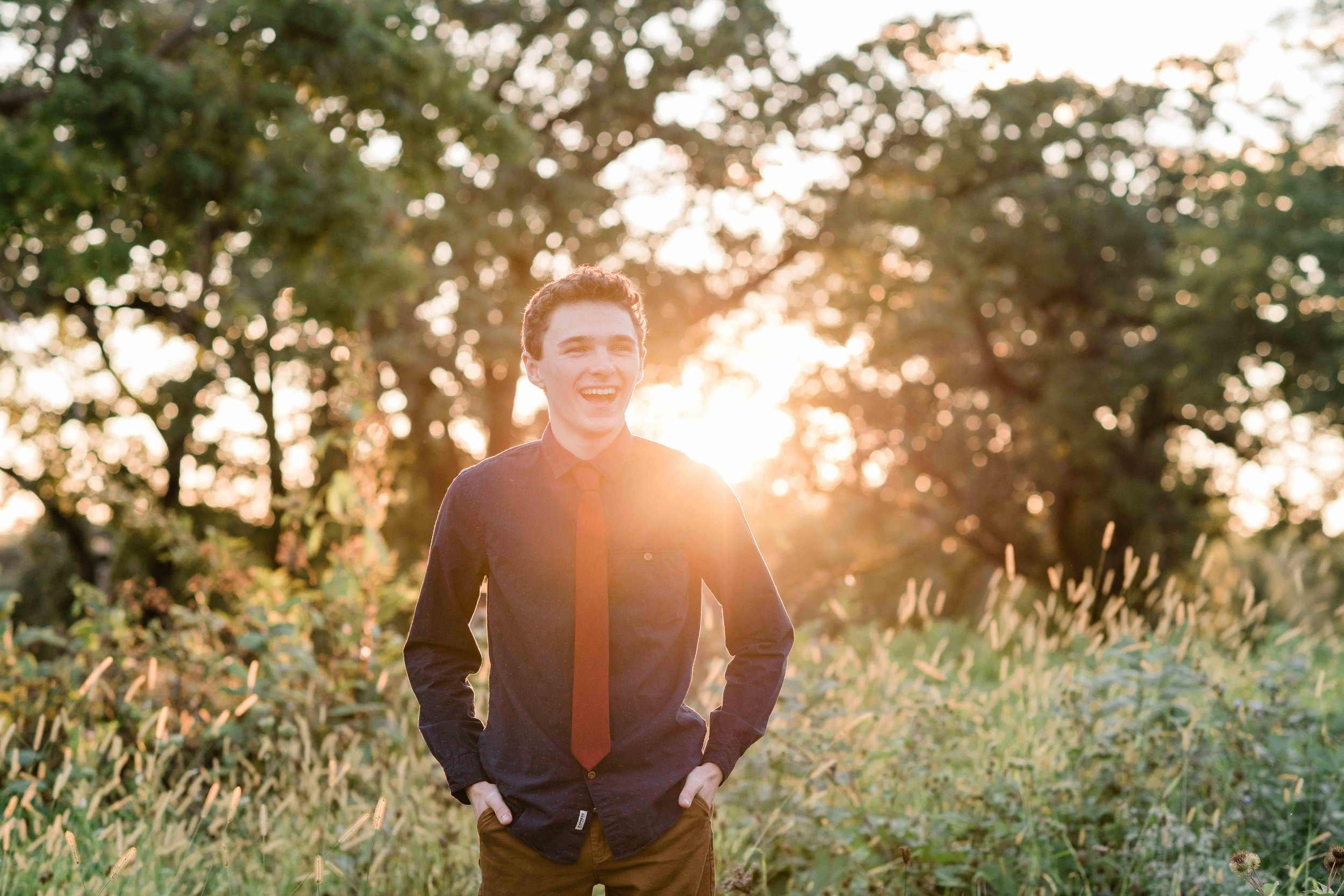 High school senior backlit by the sun
