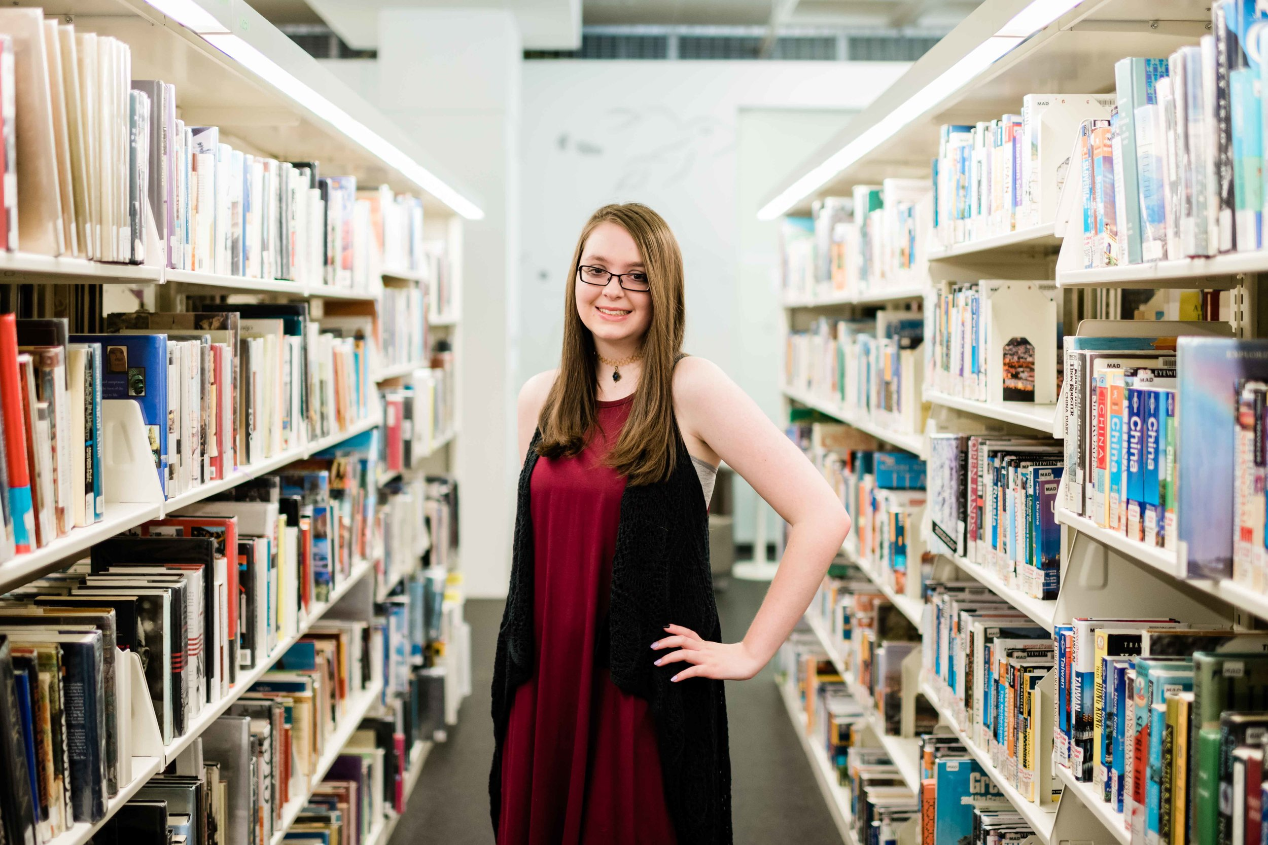 High school senior posing in the stacks at Madison Public Library in downtown Madison, Wisconsin