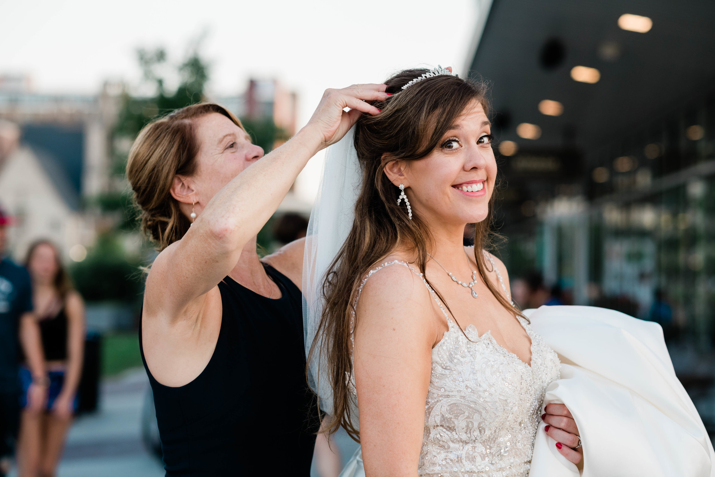 Mother putting her daughter's veil on