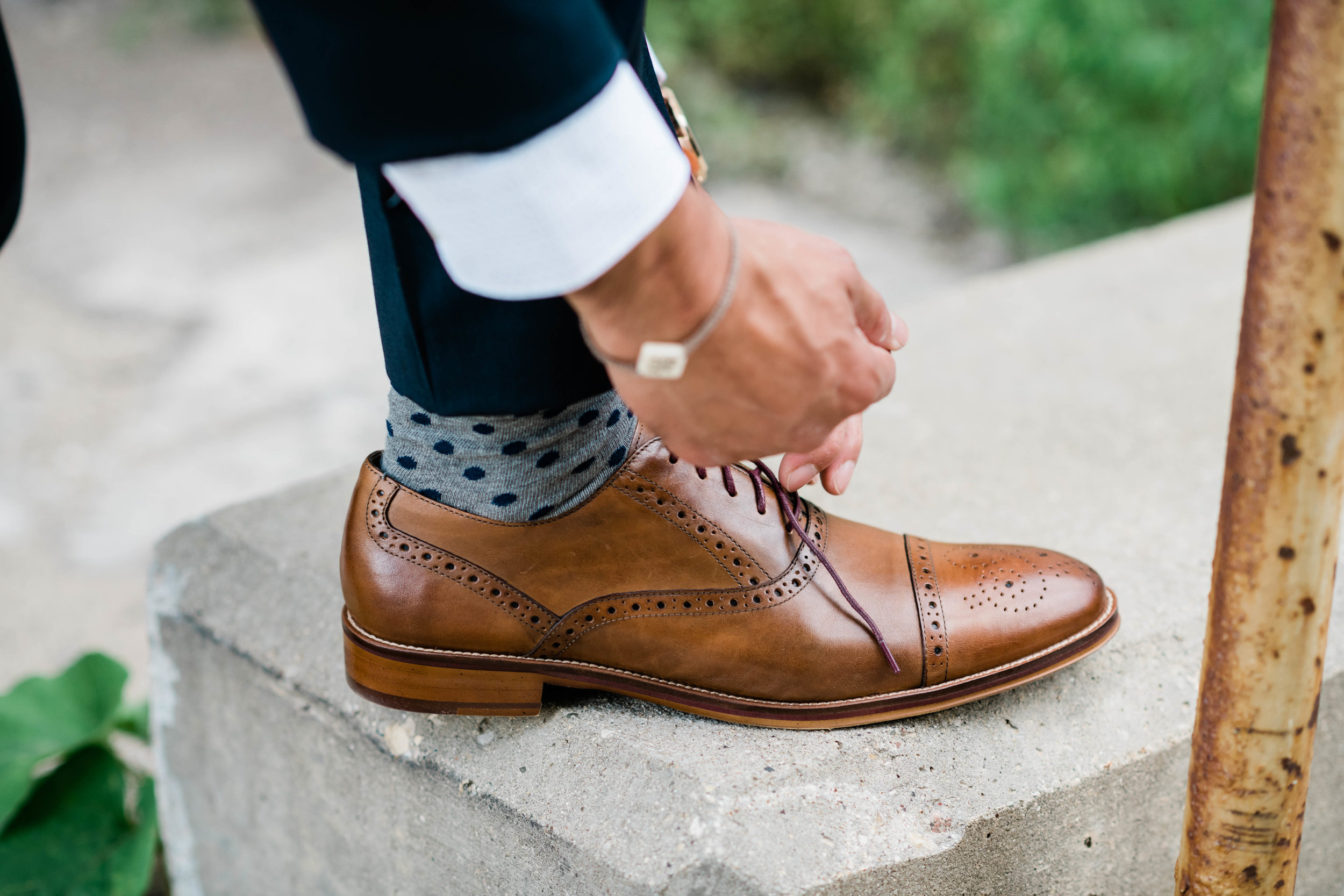 Groom tying his shoe
