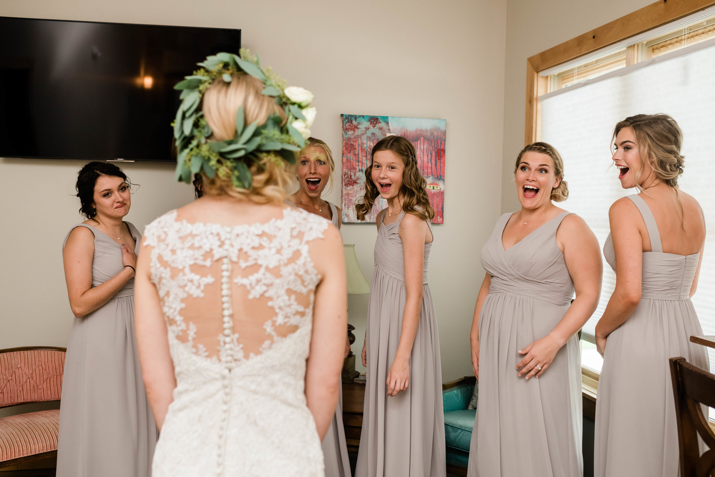 Bridesmaids react to their first look of bride