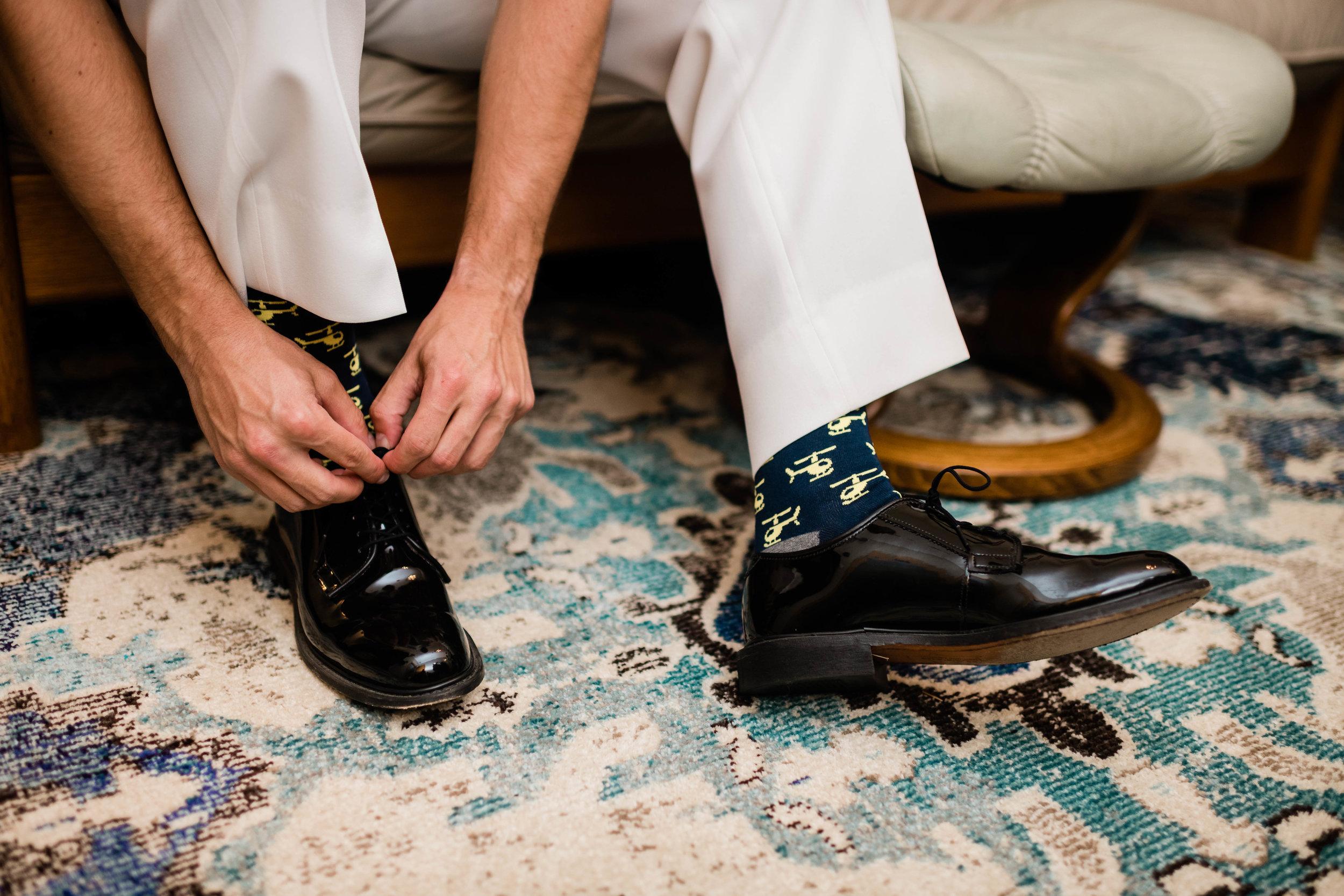 Groom ties his shoe