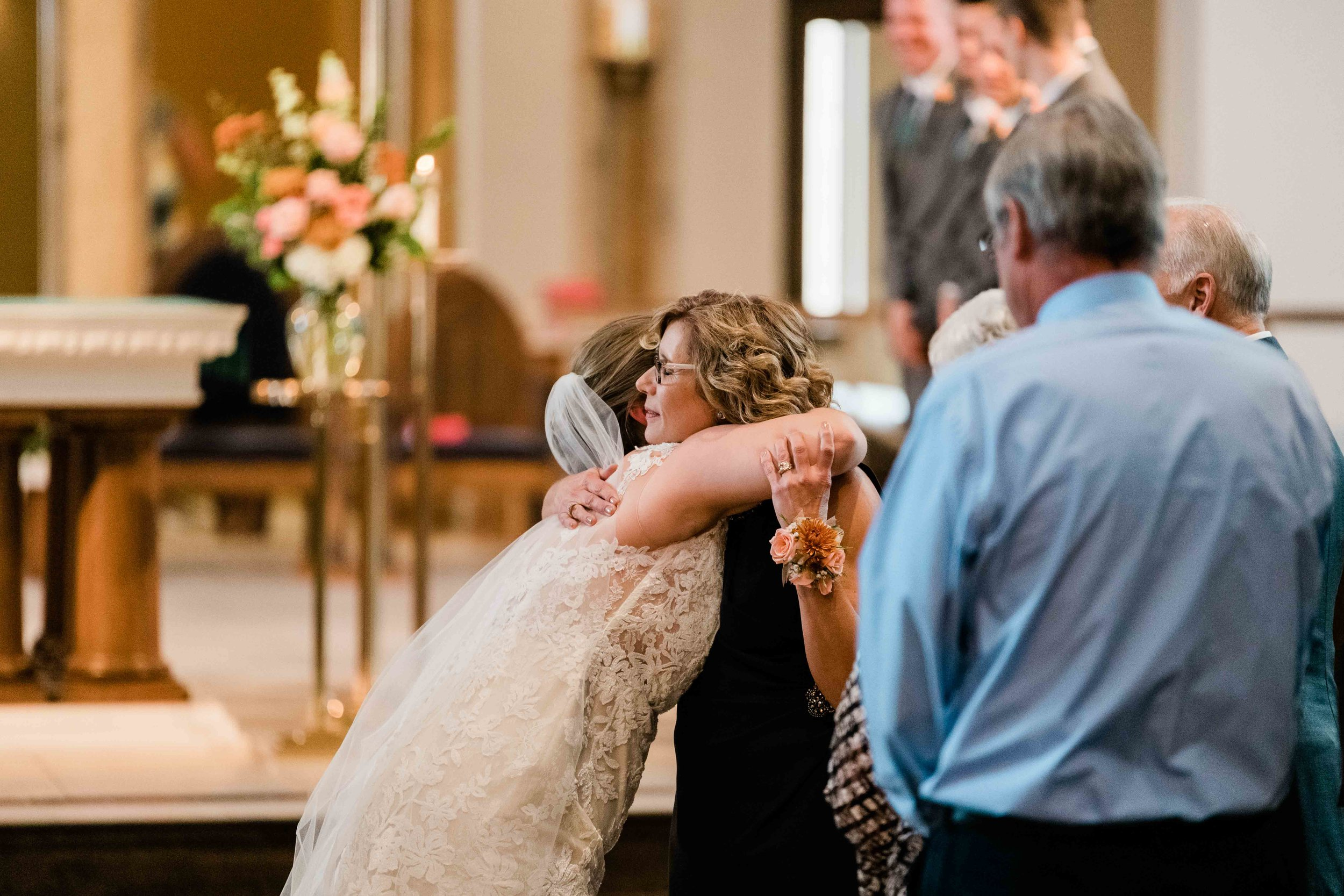 Bride hugs her new mother in law