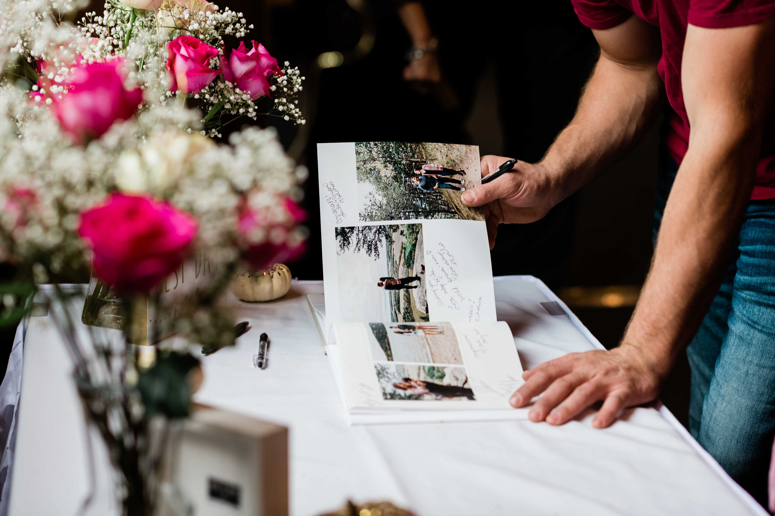 Wedding guest looks through the photo guest book