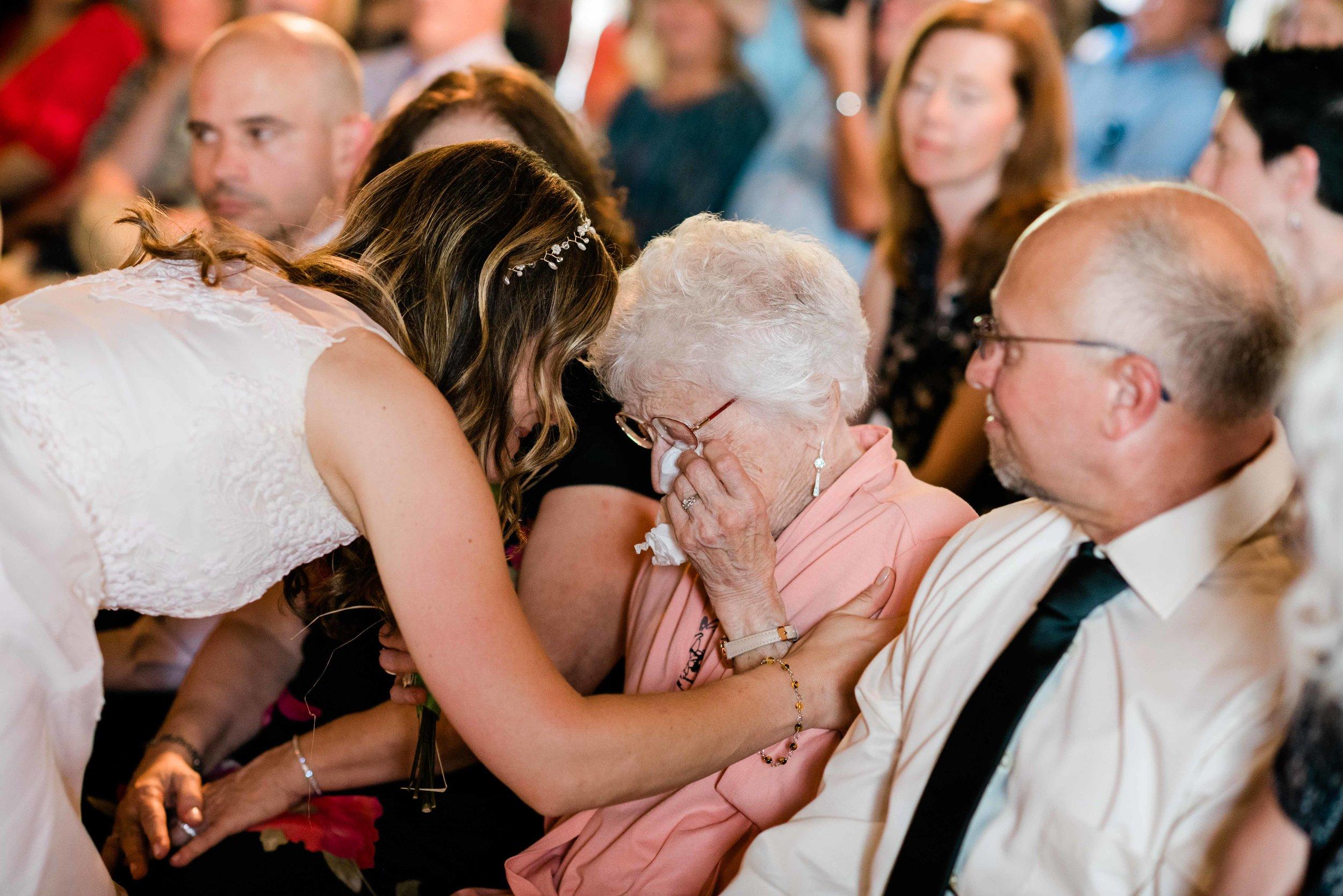 Bride comforting her grandma as she cries