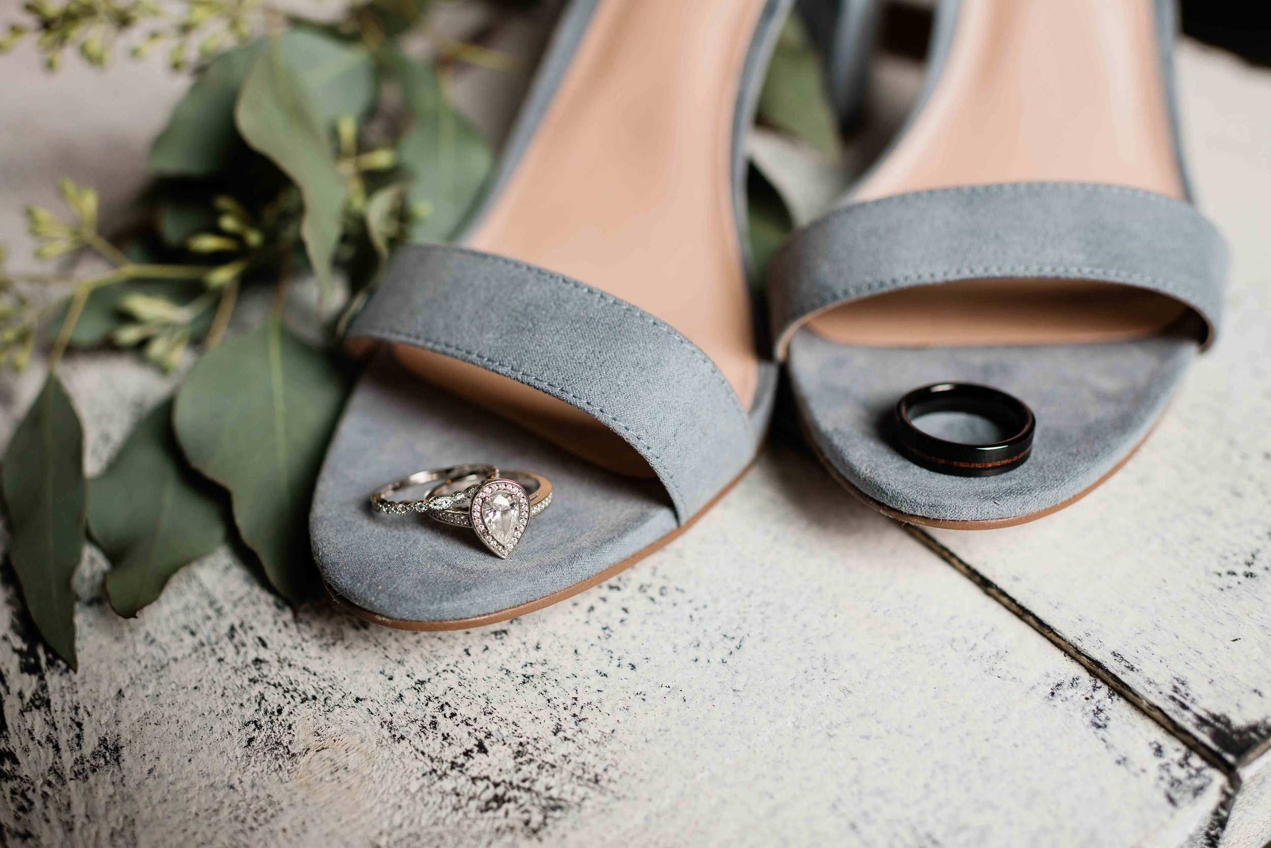 Wedding rings on bride's shoes