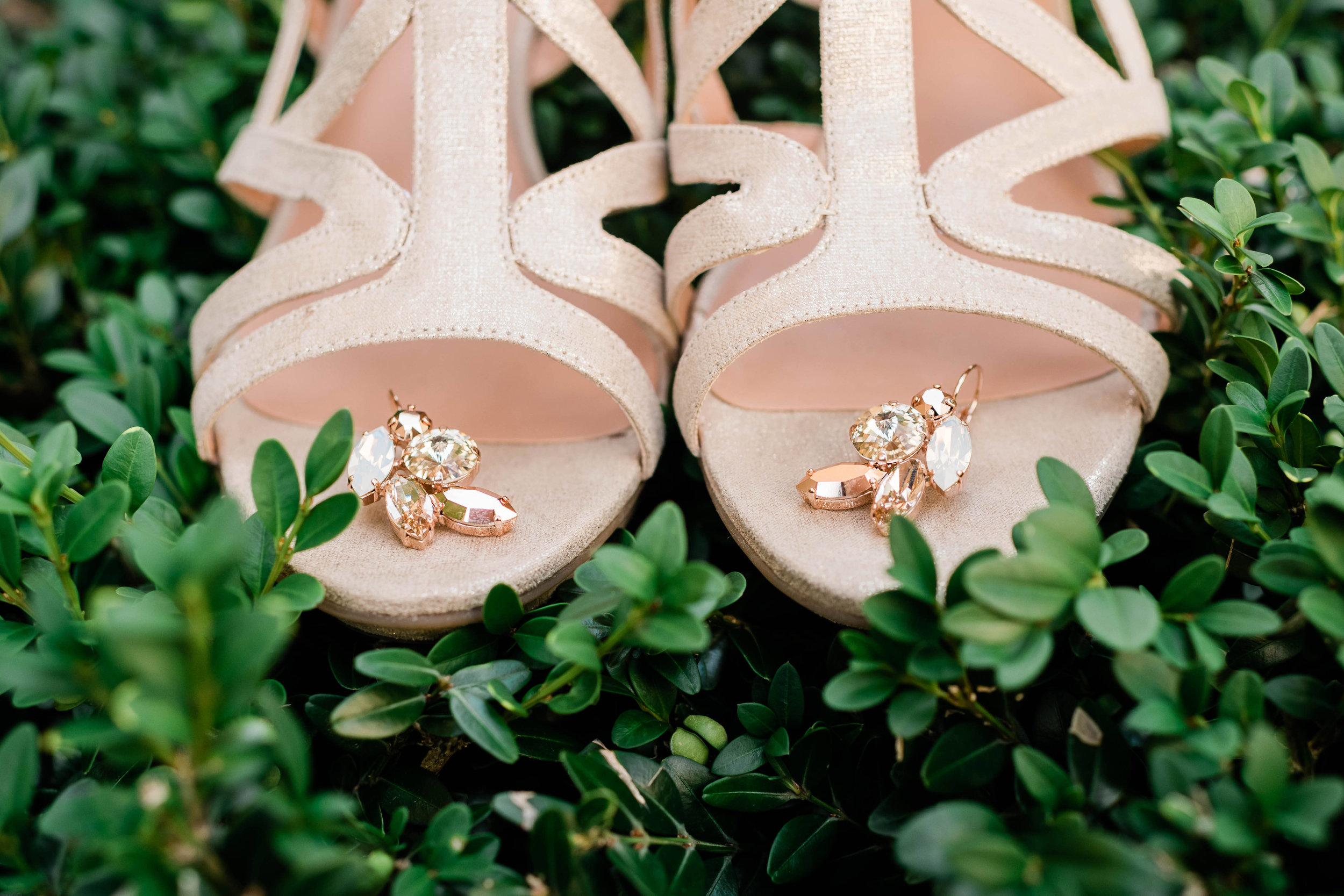Bride's earrings on her shoes