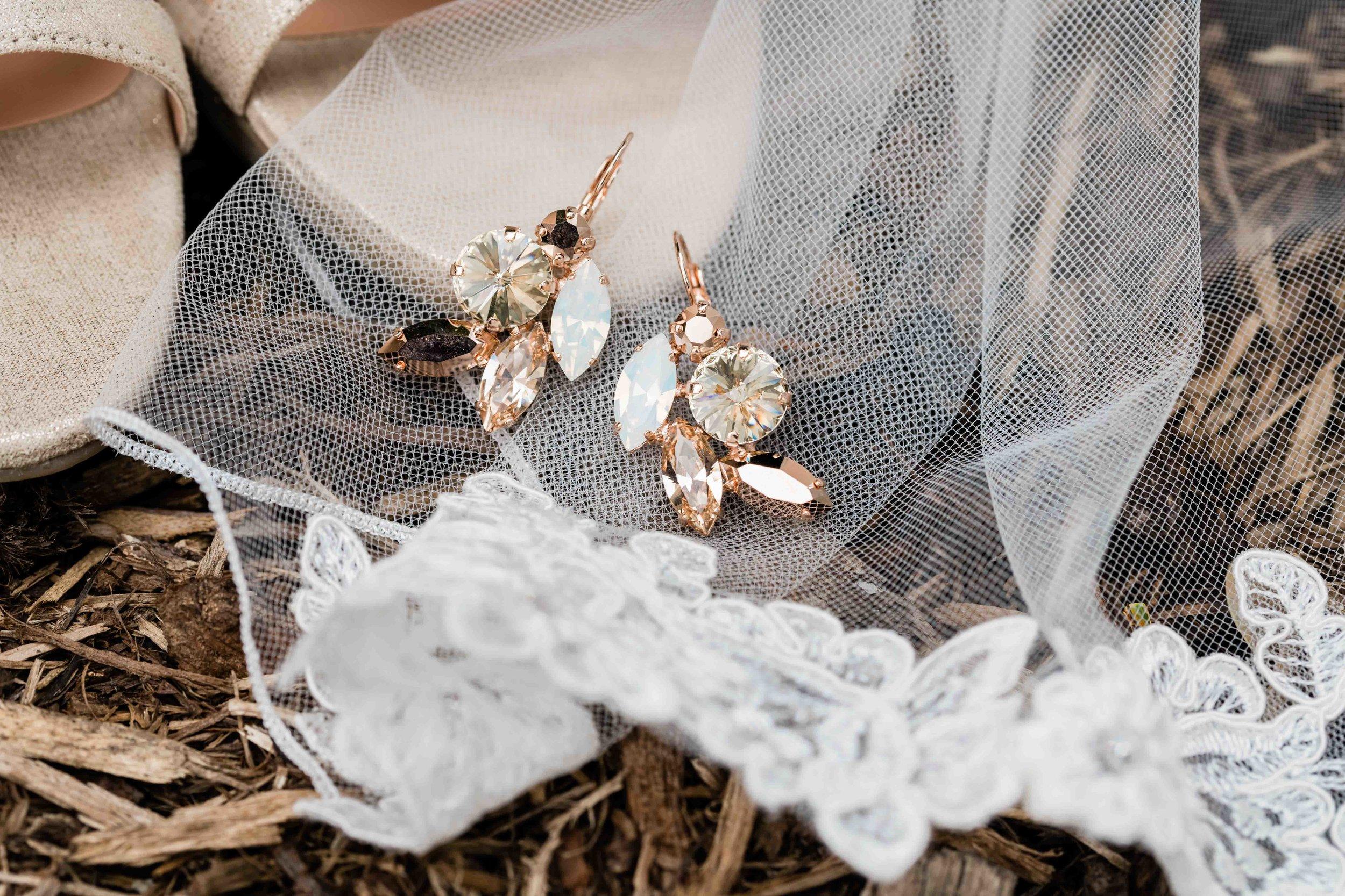 Bride's earrings on her veil