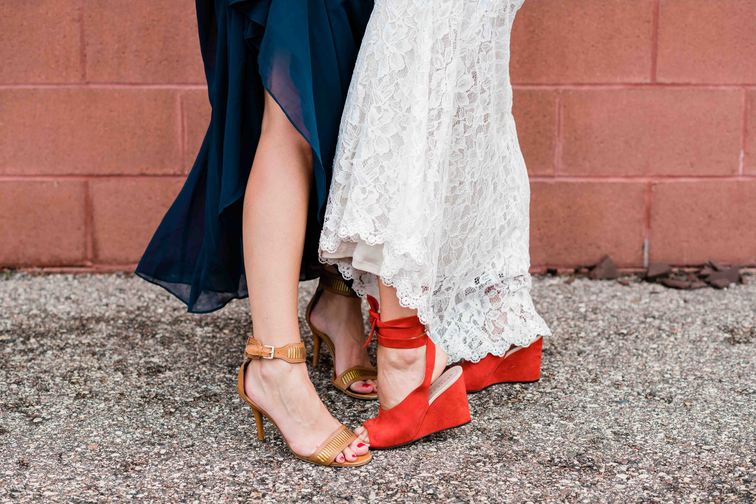 Bride and bridesmaid show off their shoes