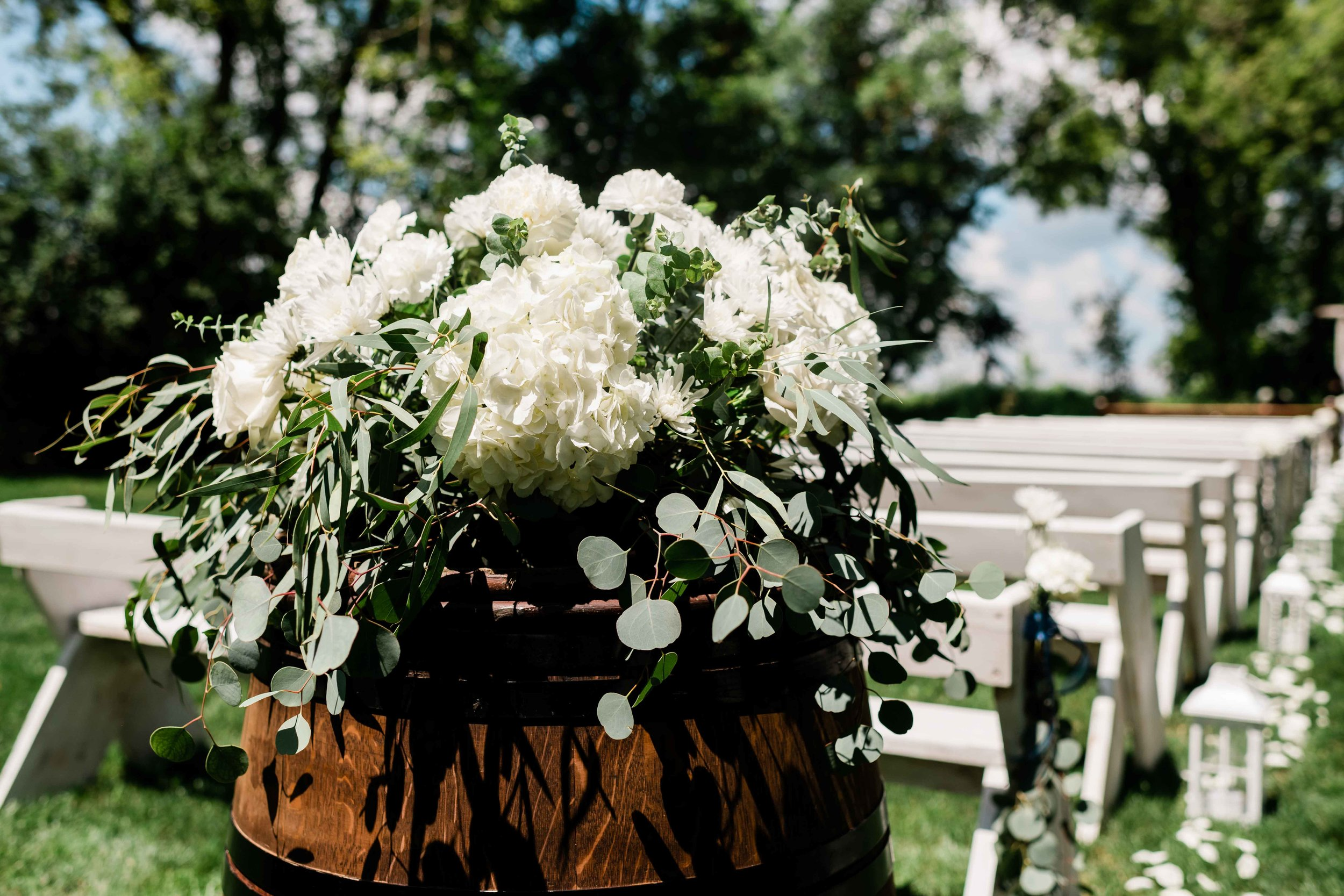 Flowers on top of wooden barrel