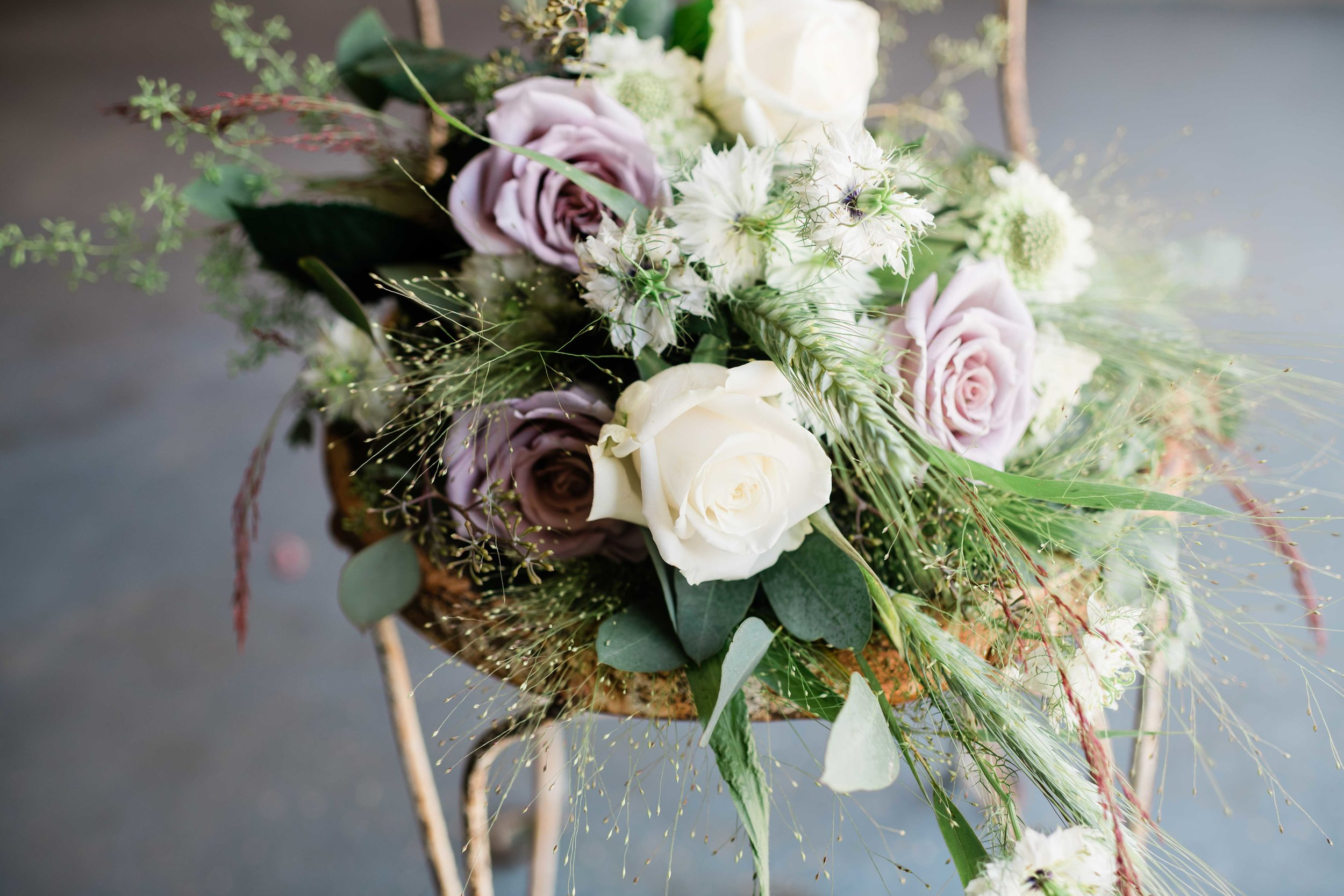 Bridal bouquet sitting on rusty chair