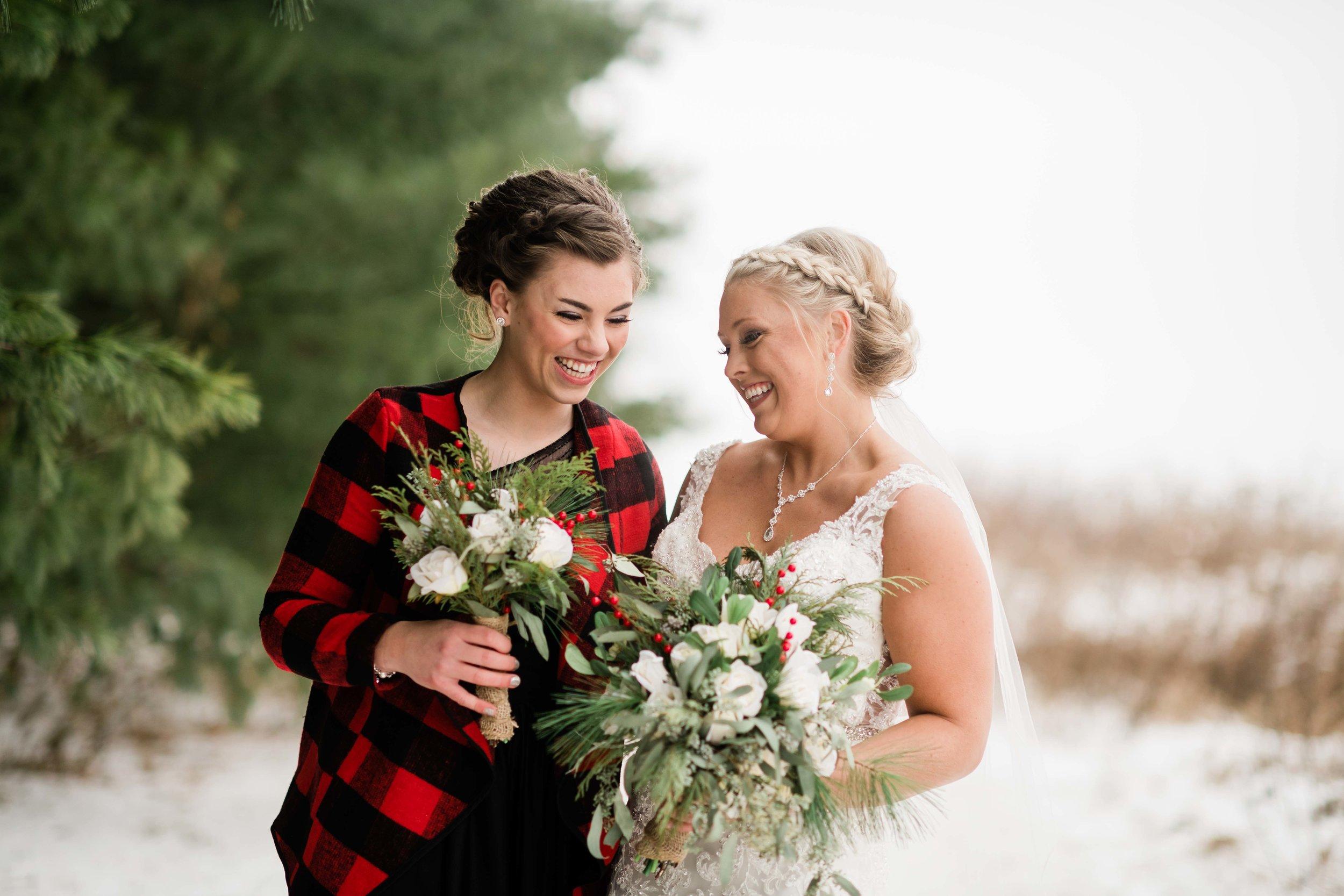 Bride and bridesmaid laugh