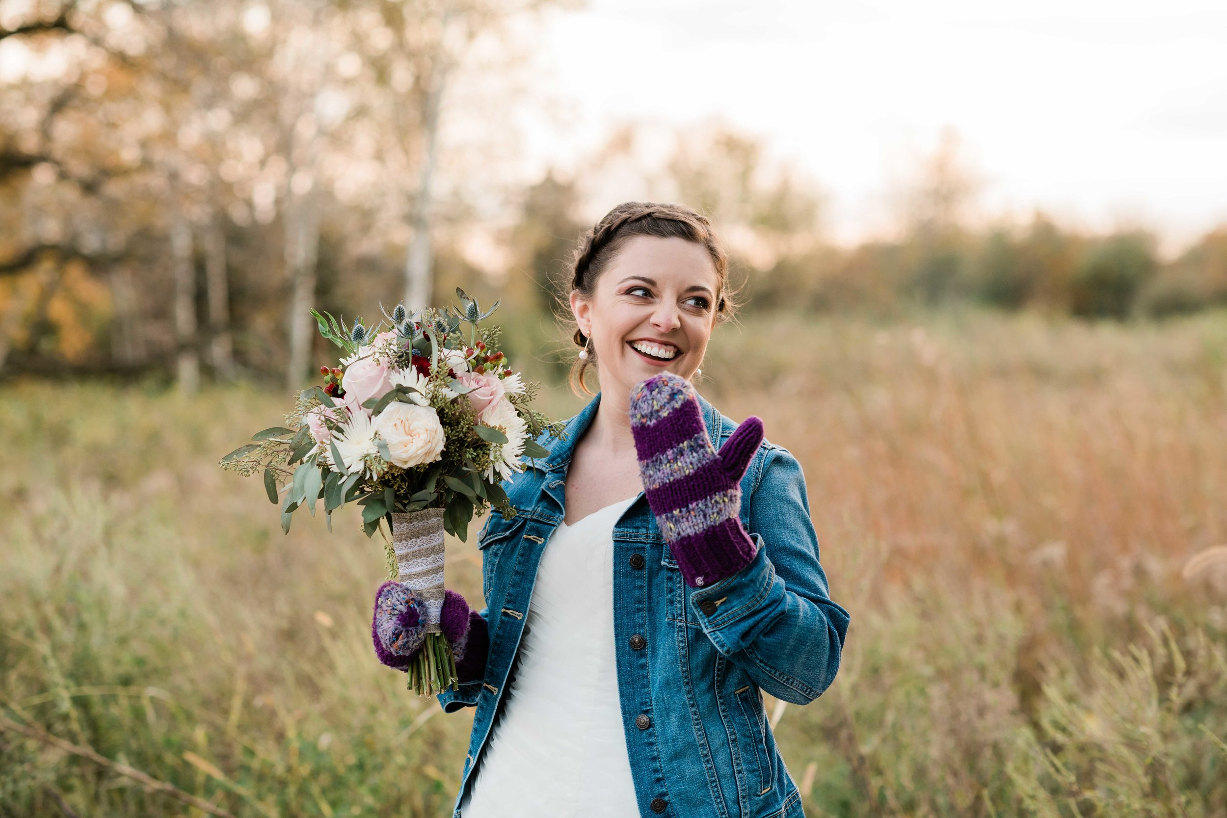 Bride wearing mittens and laughing