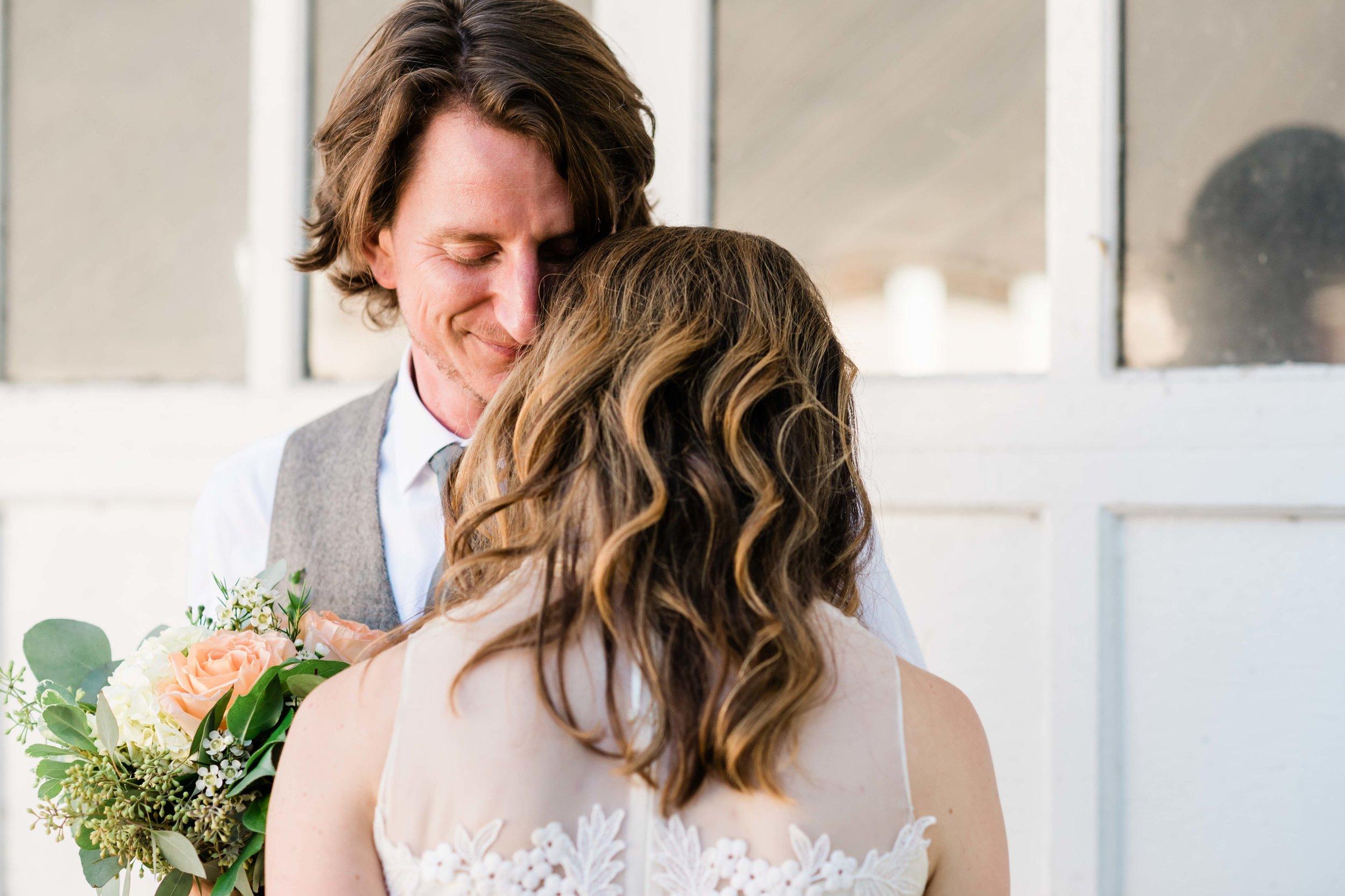 Groom smells bride's hair